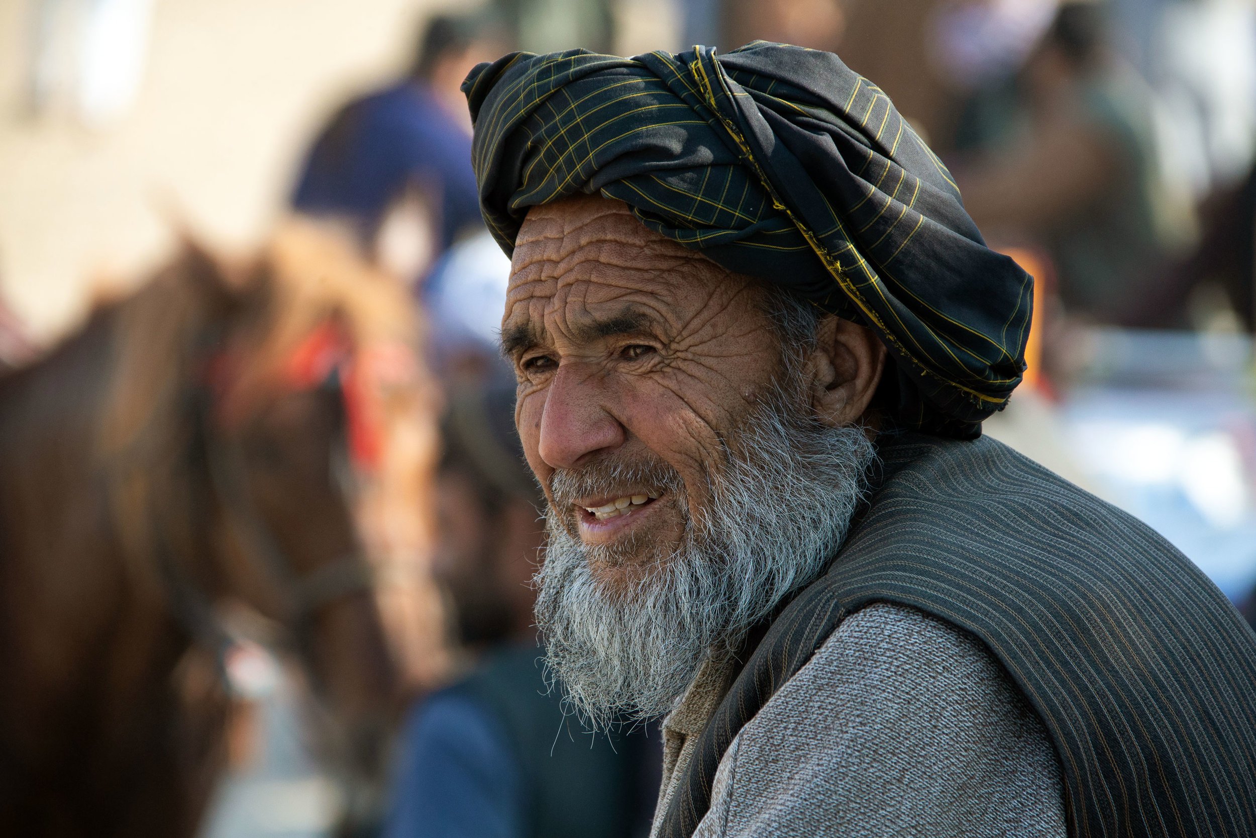 An ethnic Uzbek grandfather watches a Buzkashi match outside the city of Mazar-i Sharif in Balkh Province.