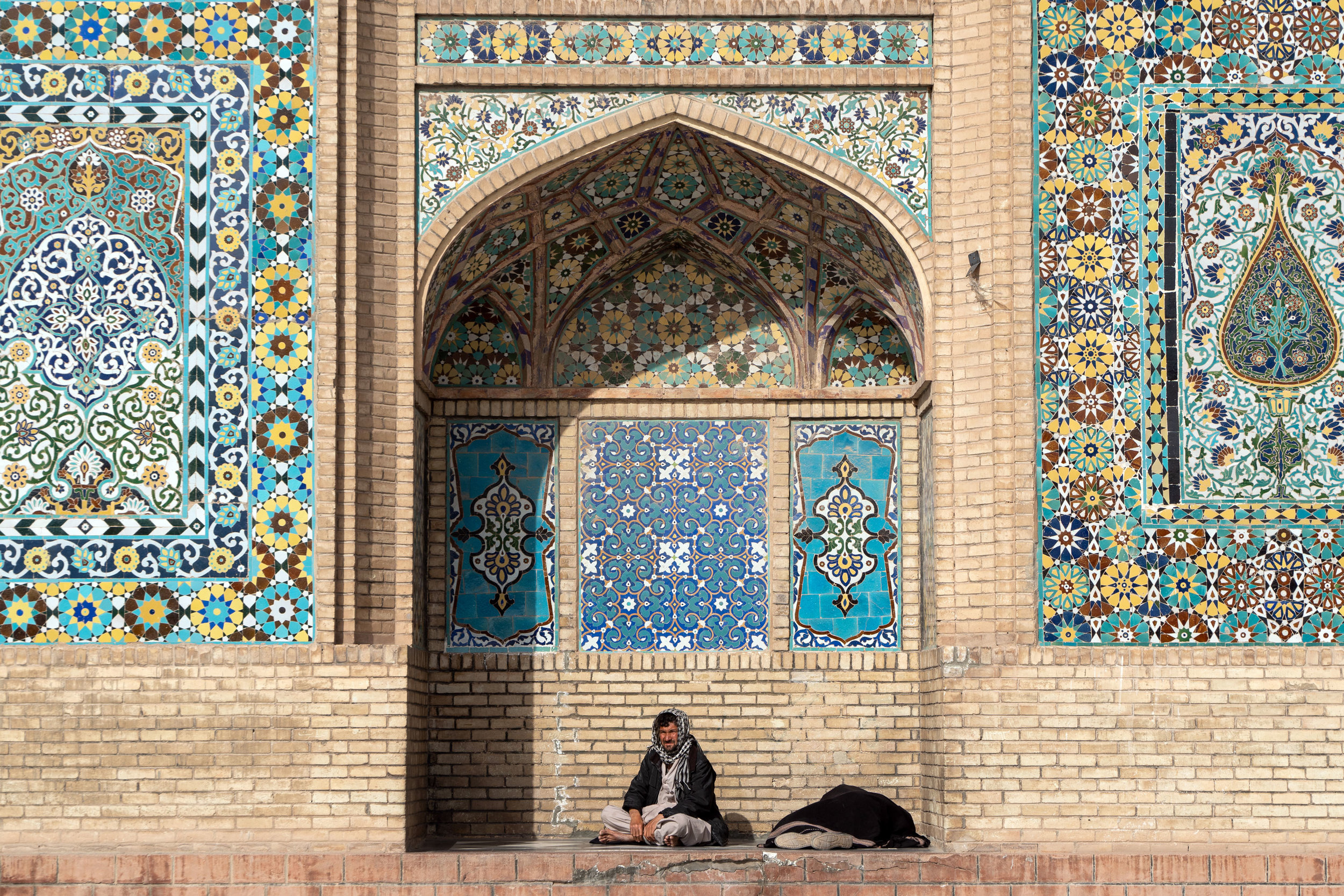 Two men take a rest in an archway at Herat's Friday Mosque.