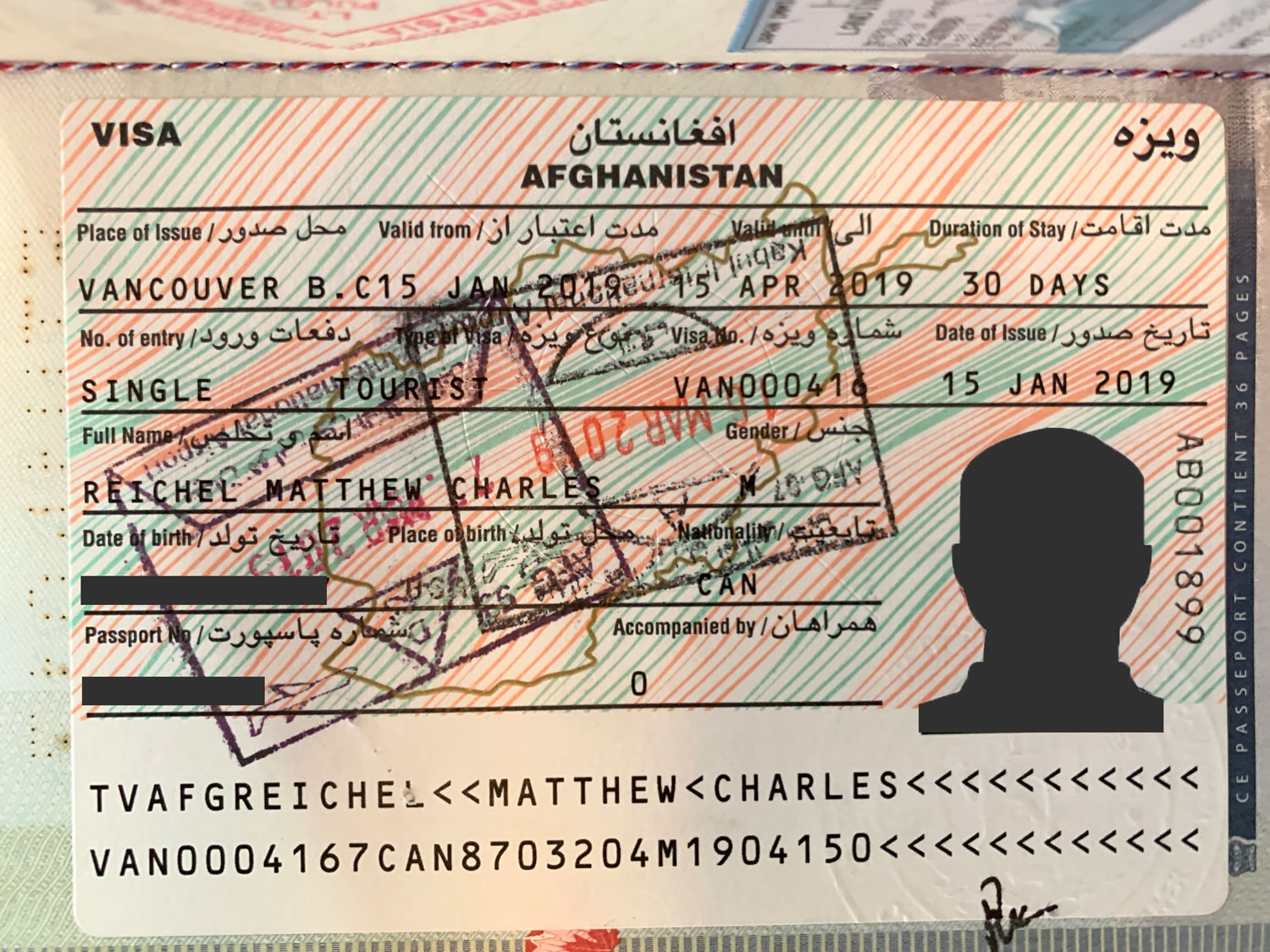 An Afghanistan tourist visa issued in a Canadian passport.