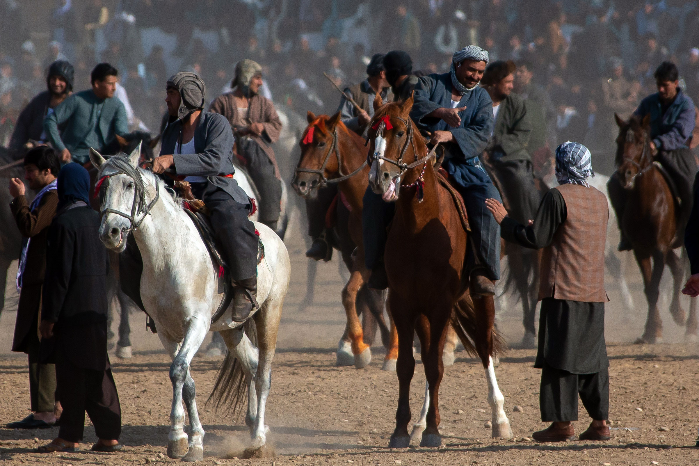 Men on horseback playing Buzkashi in Balkh.