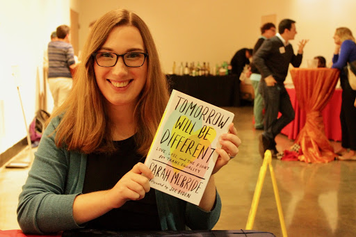 National Press Secretary for Human Rights, Sarah McBride poses with her new book Tomorrow Will Be Different at Katzen Art Center.  Photo by Roman Habibzai