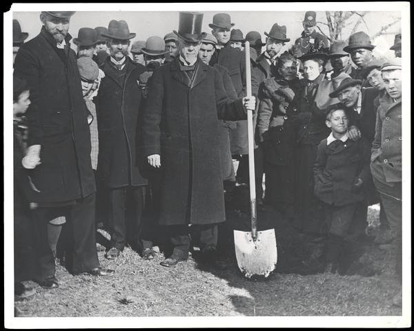 Bishop John Fletcher Hurst with shovel at groundbreaking of College of History, Hurst Hall, 9 March 1896    American University Archives