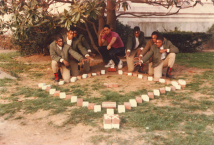Kappa Alpha Psi brothers gather around a plot during a previous commemoration ceremony | ( Image provided by the Kappa Chi Chapter of Kappa Alpha Psi Fraternity, Inc.)