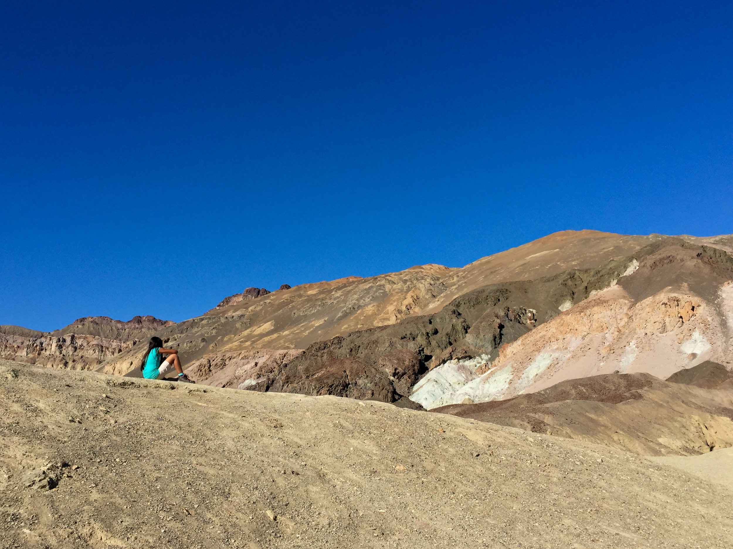 A girl surveying the Artist's Palette -- a part of the Black Mountains where rocks are colored by oxidized metals -- in 2016.