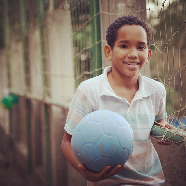 One of the kids from Alzira De Aleluia in the #Vidigal #Favela of #RioDeJaneiro taking a minute with a #OneWorldFutbol to enjoy the #view over the #Atlantic #ocean.  Built mostly in the Rocky hillsides overlooking #Rio, many #favelas have incredible views of city and ocean.  #travel #travelwithballs #travelwithpurpose #overland #wanderlust #soccer #worldcup #brasil #brazil