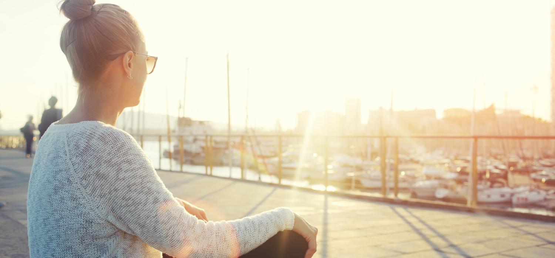 Young hipster girl enjoying sun and good warm day.jpg