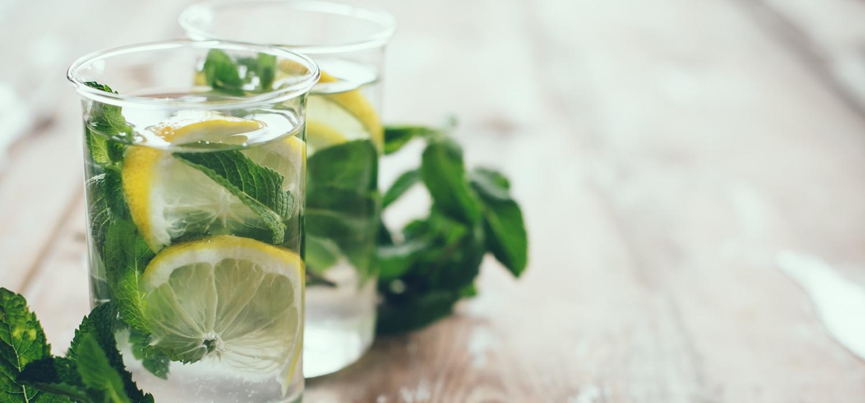 lemon-herbs-water-in-glass-to-promote-eating-healthy.jpg