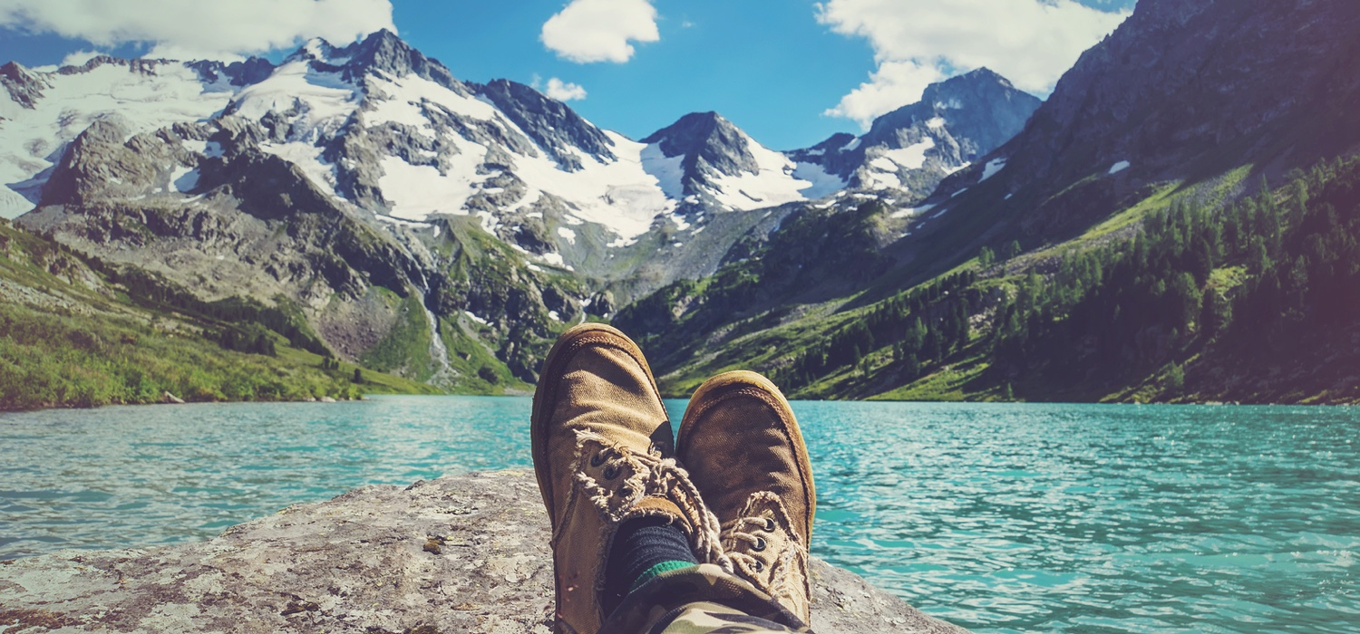 healthy-man-relaxing-by-lake-and-mountians-thinking-about-the-future.jpg
