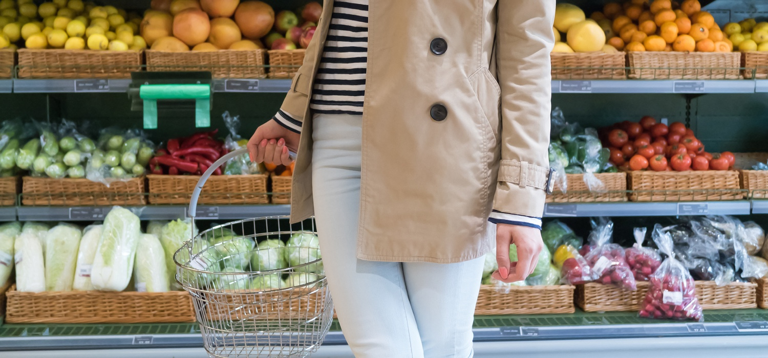 women-shopping-for-eating-by-design-on-a-budget-fruits-vegtables-in-background.jpg