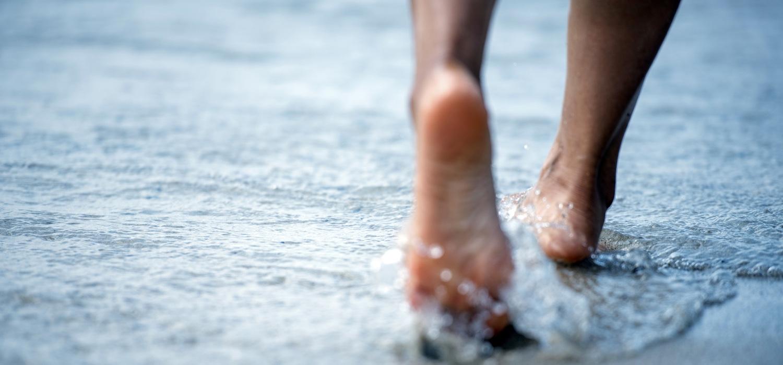 beautiful-skin-feet-walking-in-the-water-at-beach.jpg
