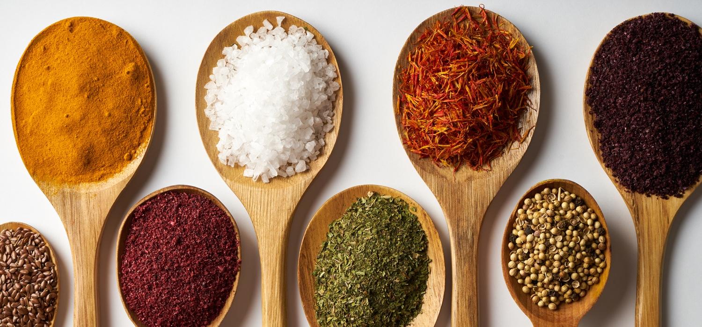 bulk herbs on wooden spoons.jpg