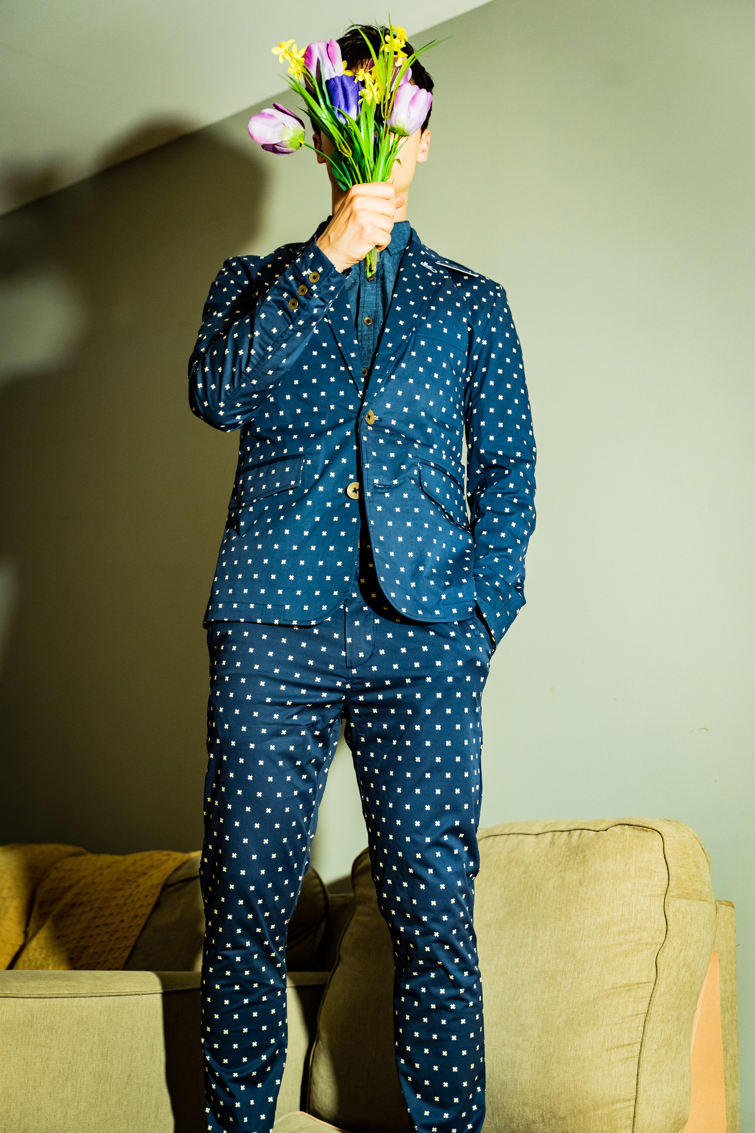 "A navy suit with an ""x"" scattered all over it? The good thing is that people will instantly appreciate your outfit. The bad thing is that your face, however handsome it may be, becomes slightly irrelevant…"