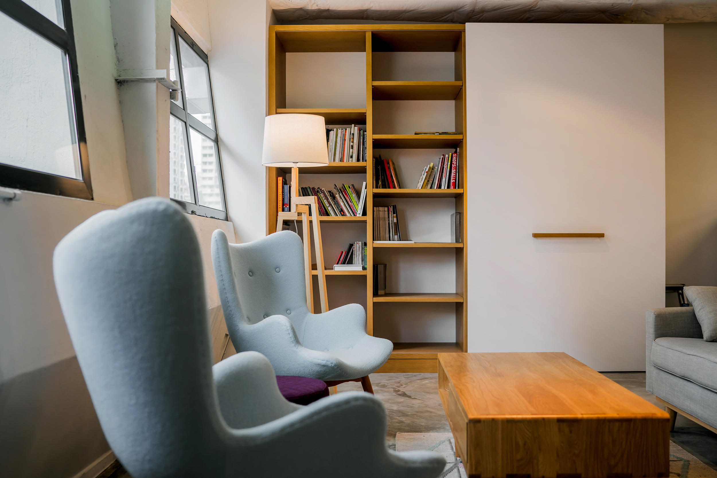The social lounge with a transformable library and pantry unit.