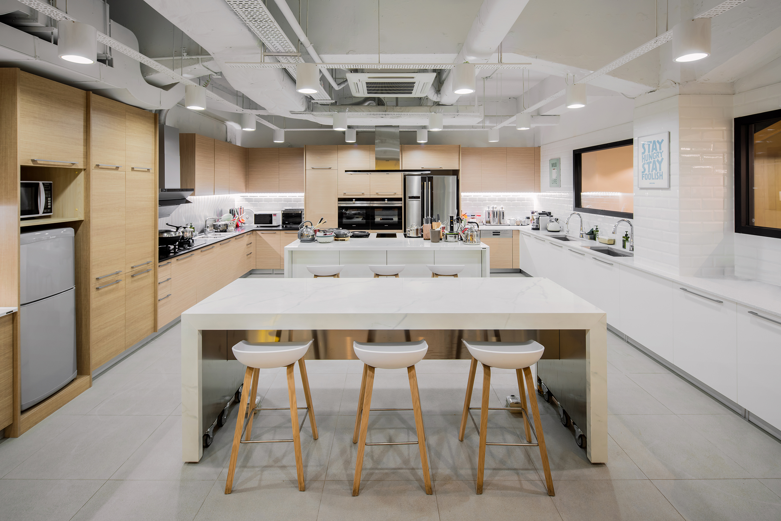 Global kitchen featuring Western, Chinese and Japanese kitchen layouts to facilitate product development and testing procedures. Cooking demonstrations and classes could also be held here.