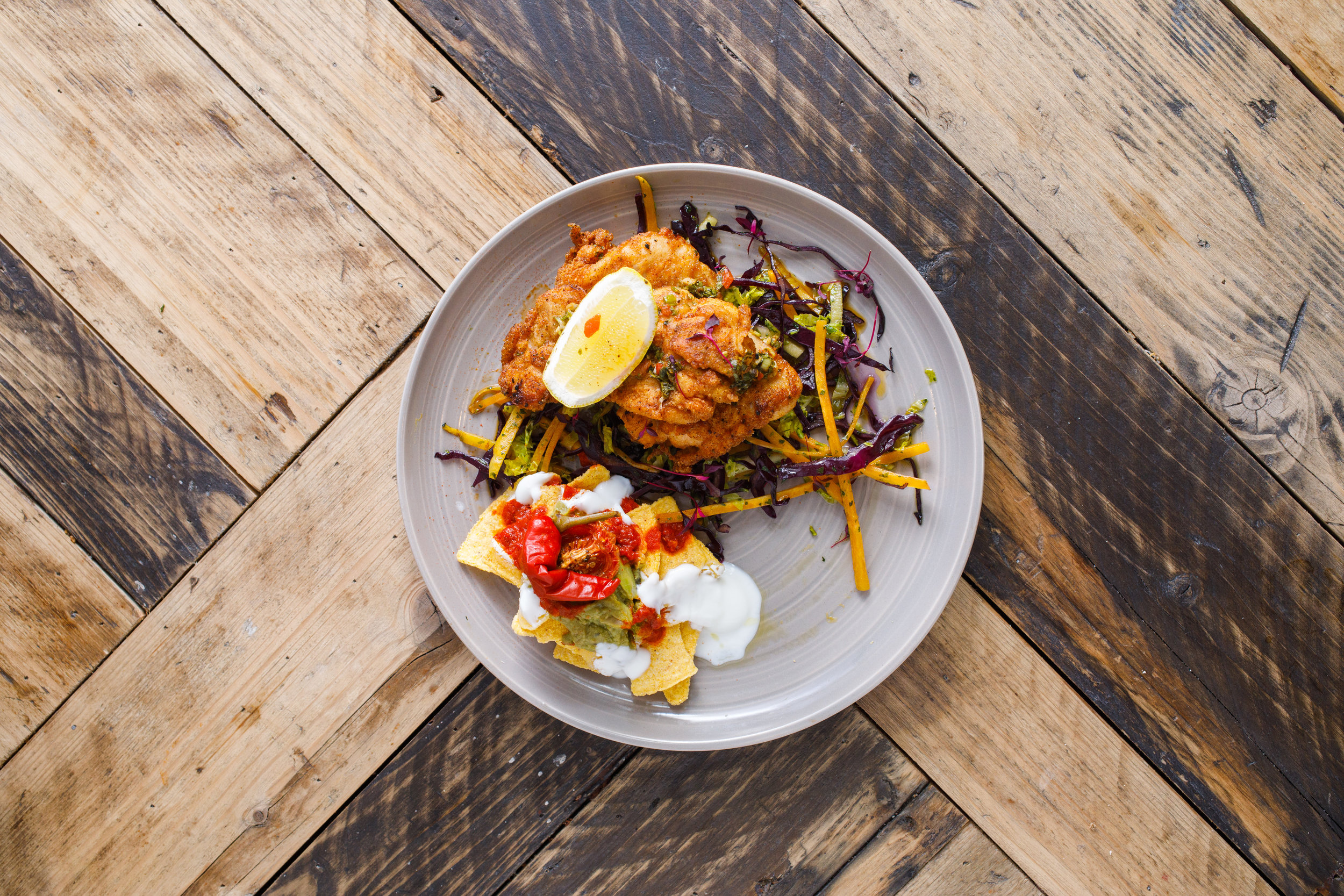 Get that Friday feeling with some fiery Mexican crispy fried chicken with a smoke adobo chilli glaze sauce. Our veggie and vegan option? Refried pinto bean fritter with smoked pickled chilli, puy lentil and mango salsa picante. Both come with shredded slaw salad, nachos, salsa, sour cream (meat and veggie only) and guacamole.