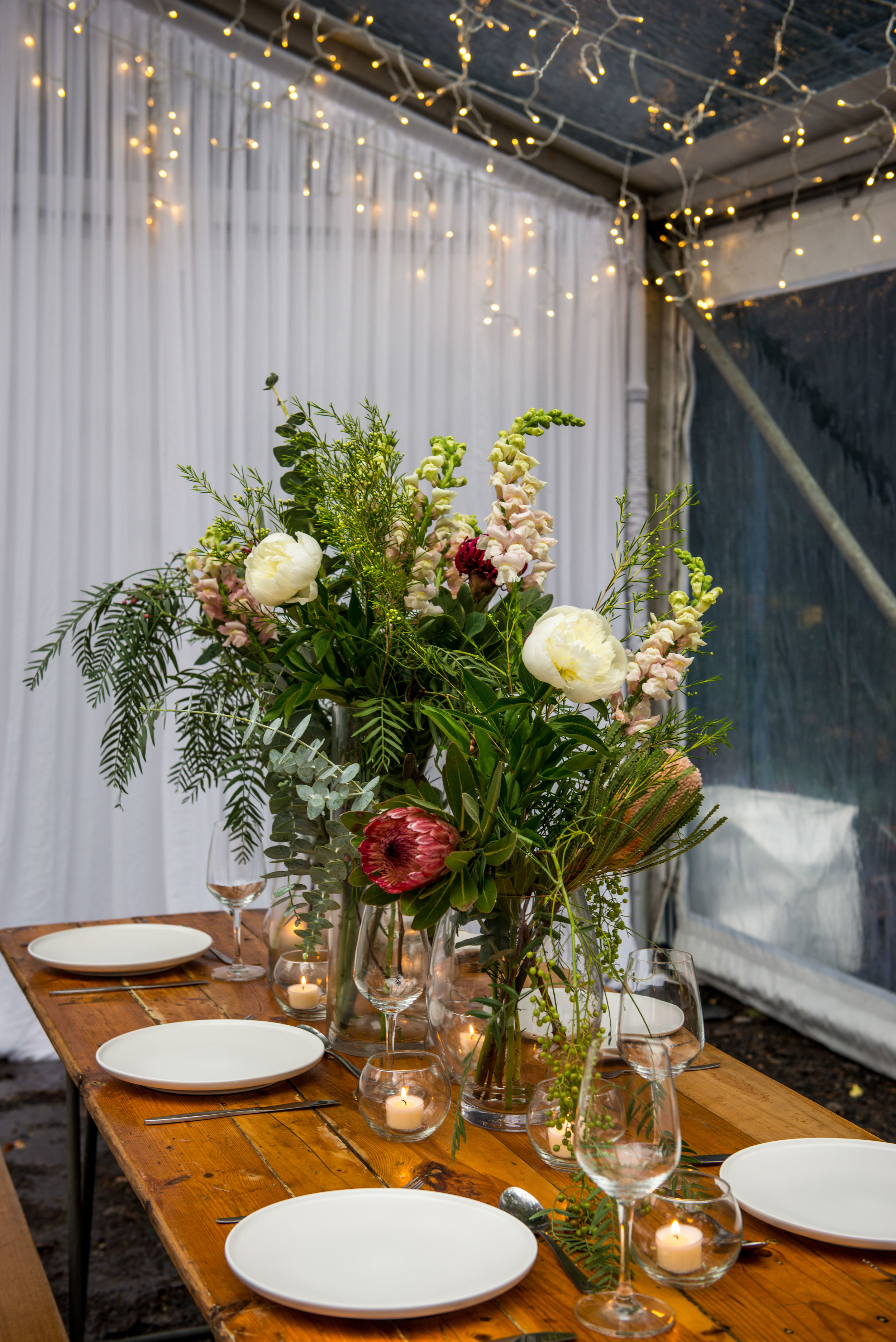 SEEN HERE   Fairy Light Canopy  Naked Wooden Trestle Table