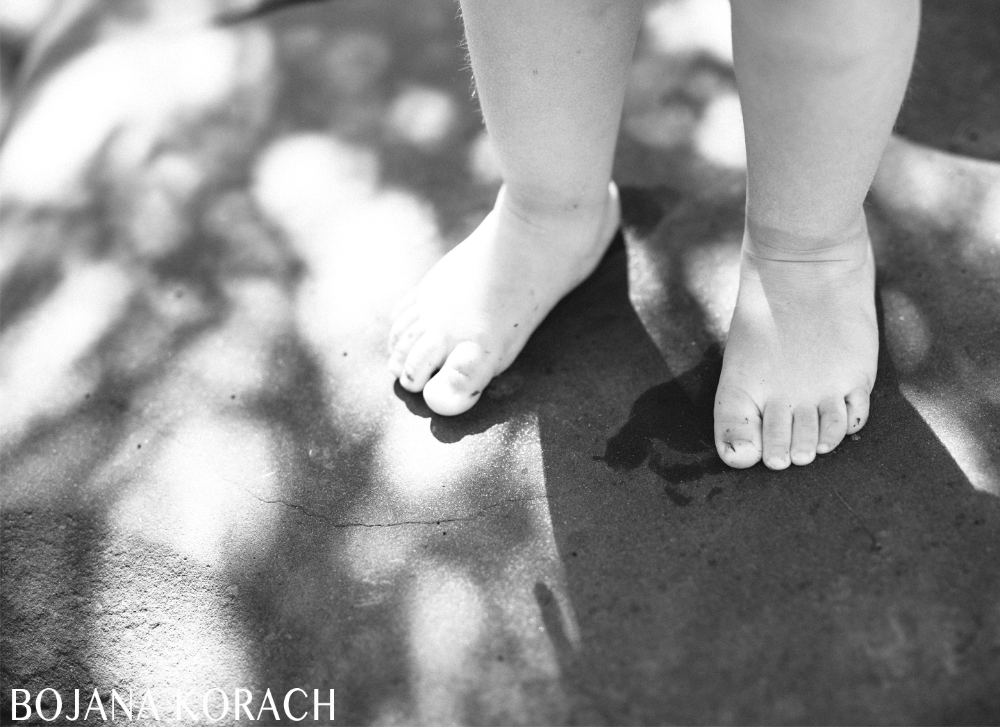 child's feet in the shade