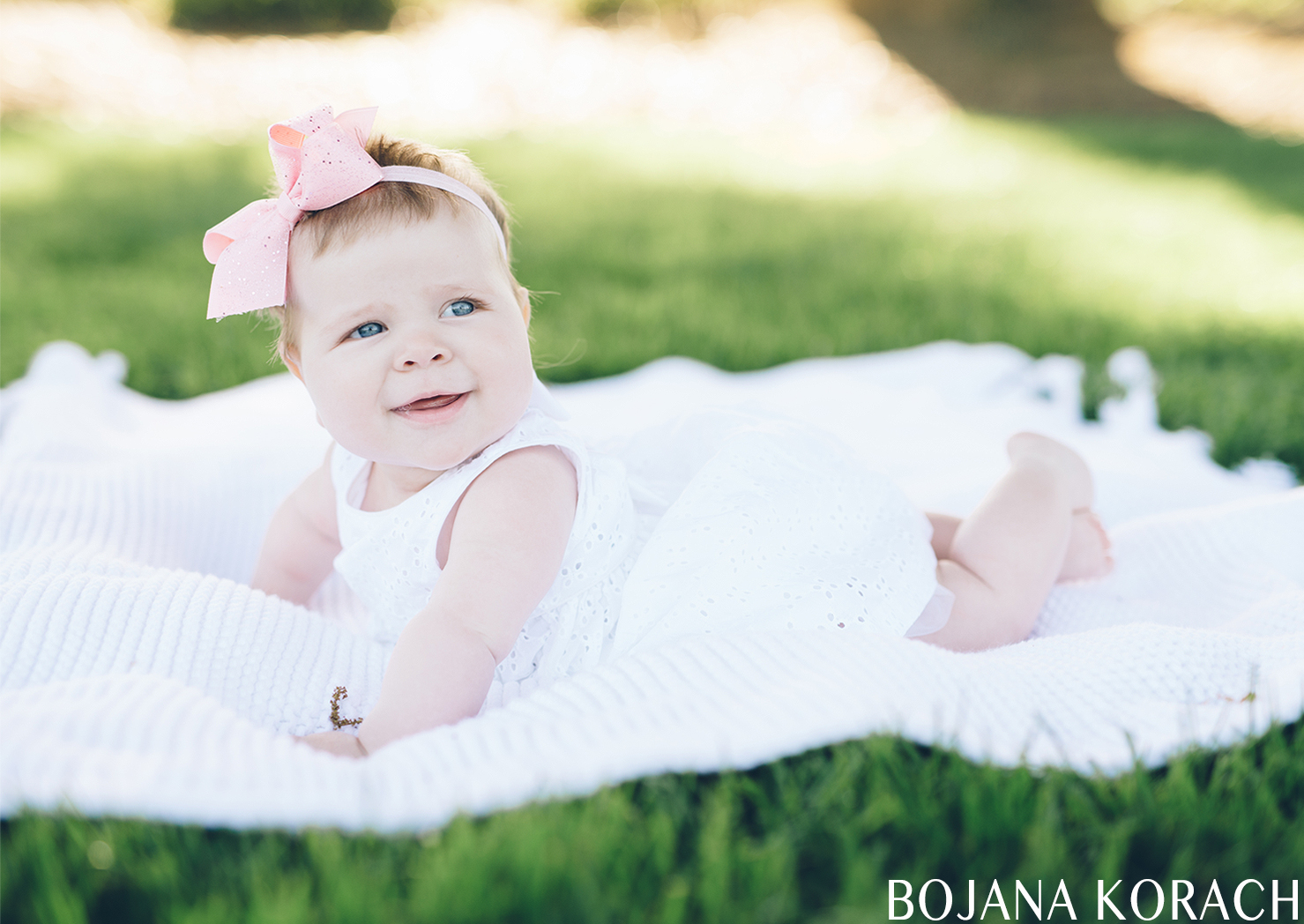 baby girl laying on the lawn at stanford university