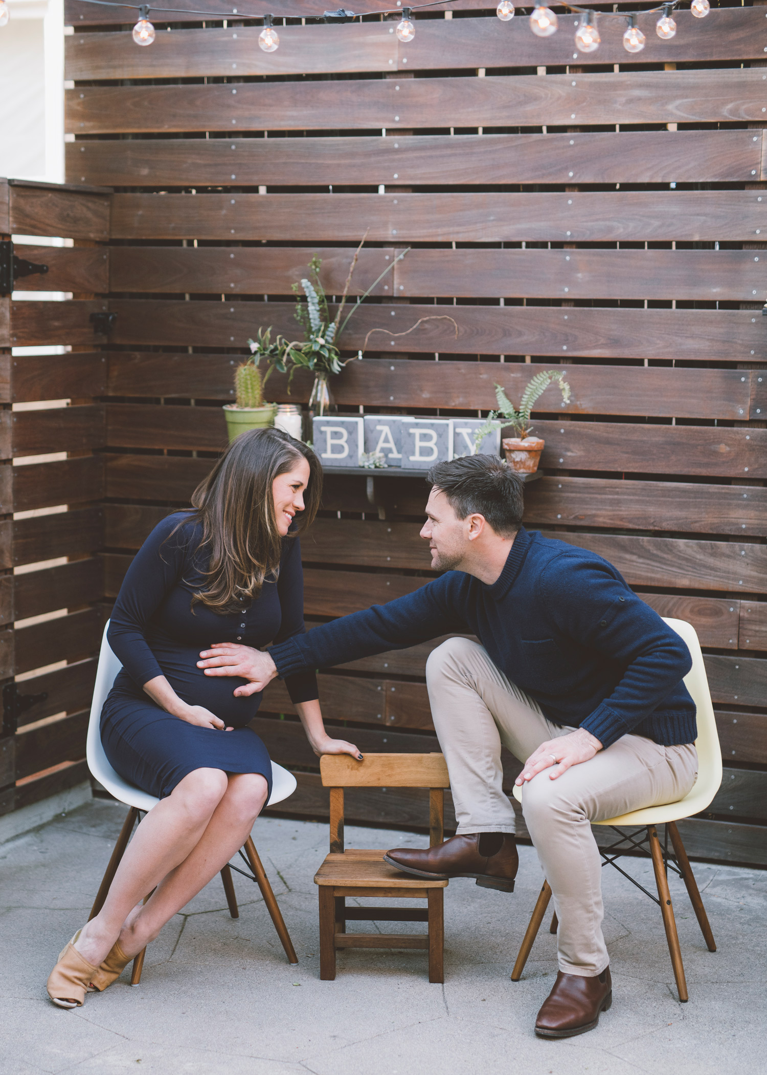 wife-and-husband-maternity-session-with-a-third-chair.jpg