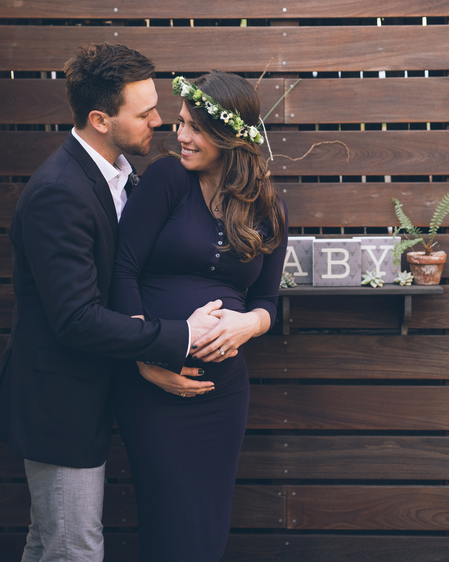husband-and-wife-looking-at-each-other-lovingly-during-maternity-session-in-oakland.jpg