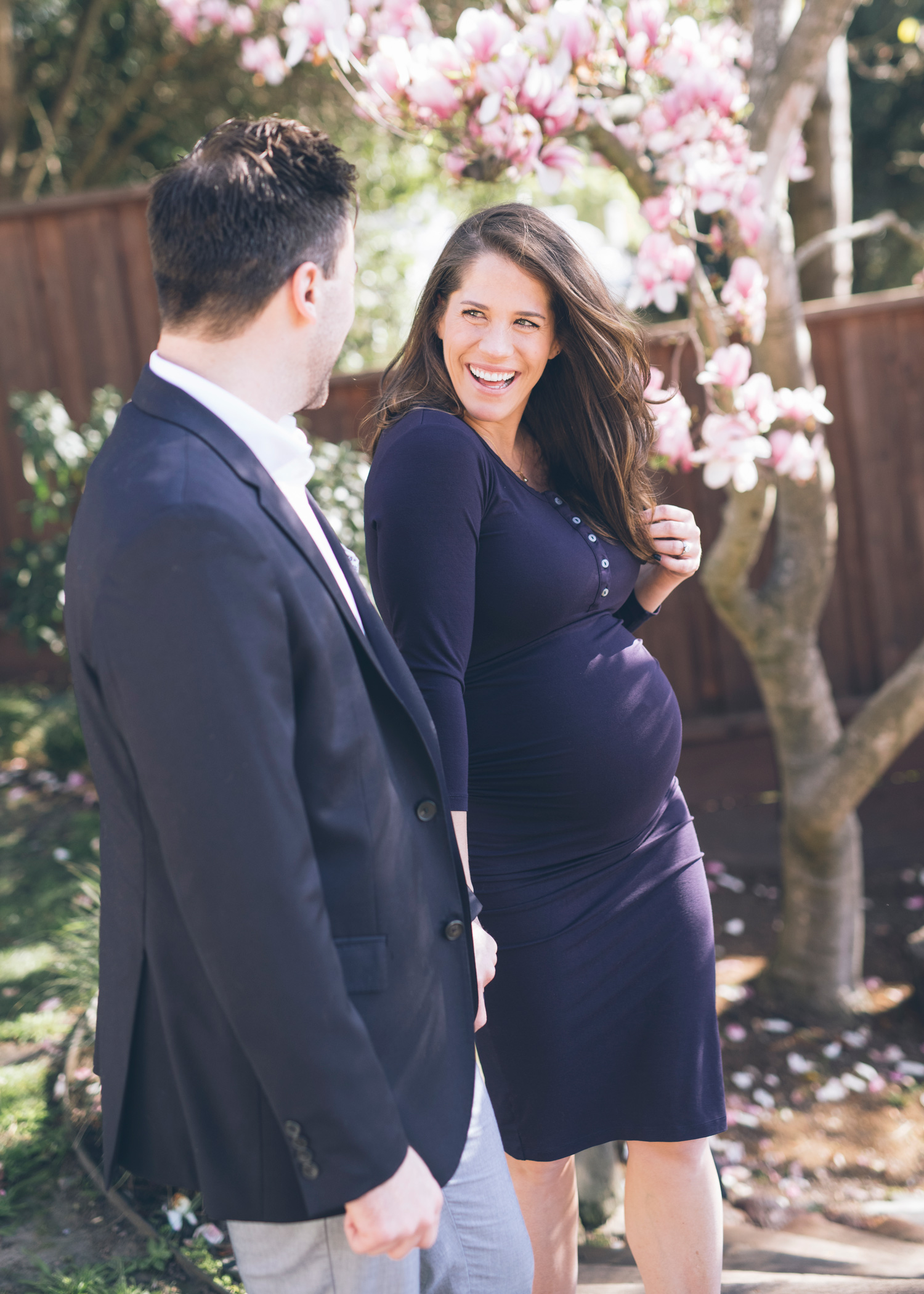 beautiful-pregnant-wife-looking-at-her-husband-with-a-huge-smile.jpg