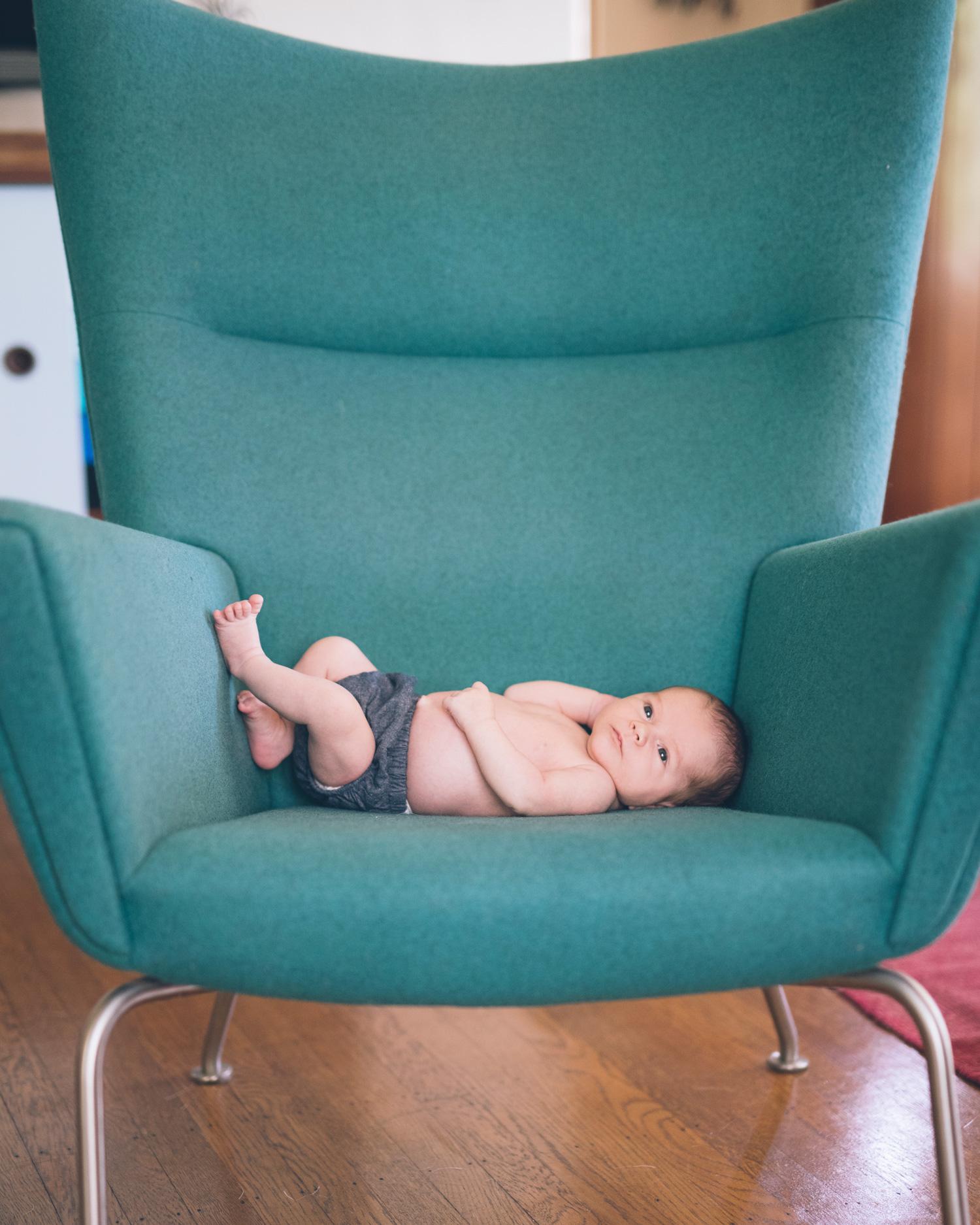 newborn-baby-boy-on-a-mid-century-modern-green-chair.jpg