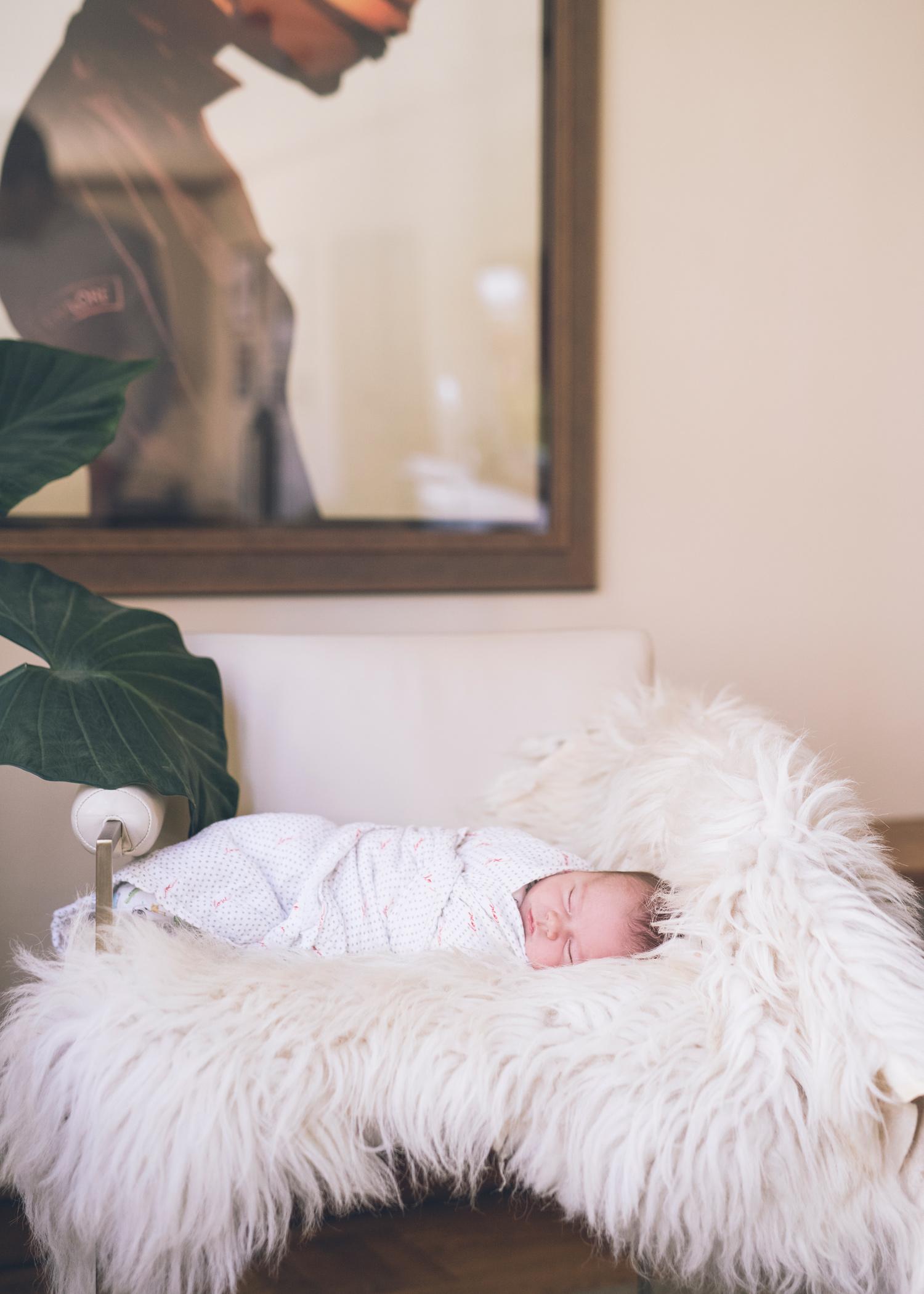 nebworn-baby-sleeping-on-a-furry-throw-on-a-chair.jpg
