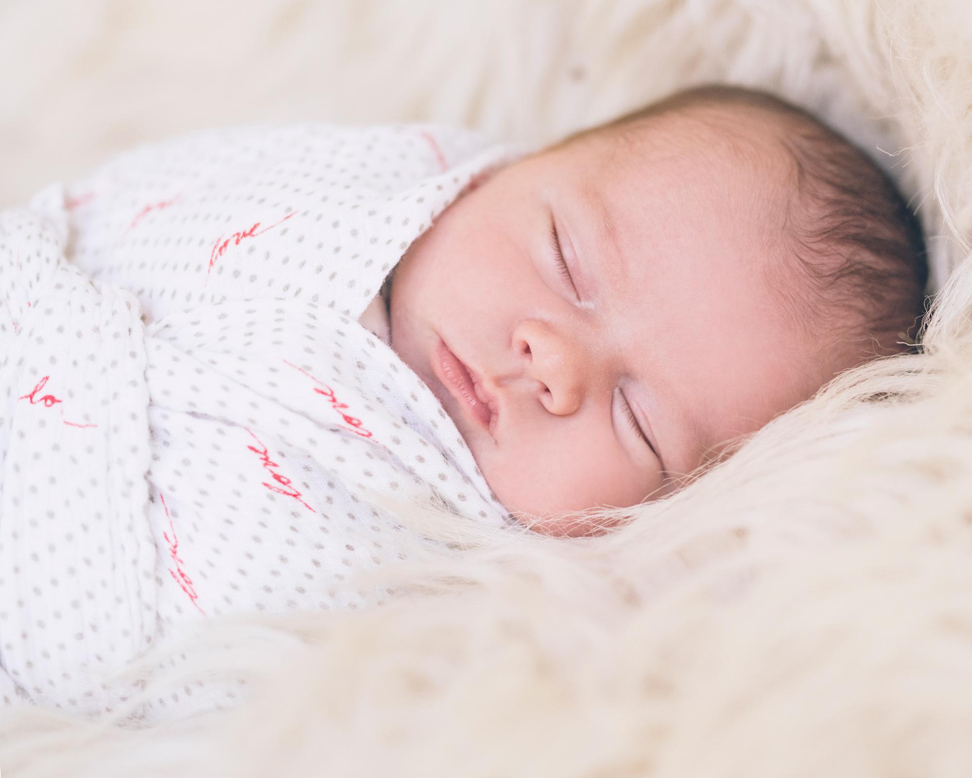 newborn-baby-boy-wrapped-on-fur.jpg