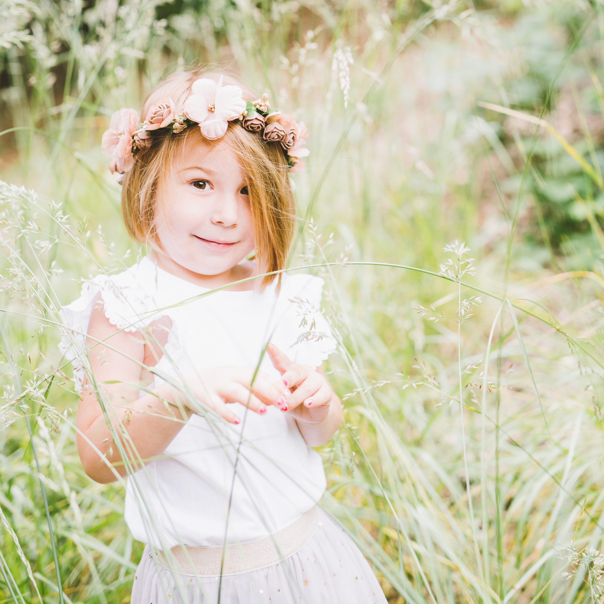 beautiful-girl-photographed-through-the-grass.jpg