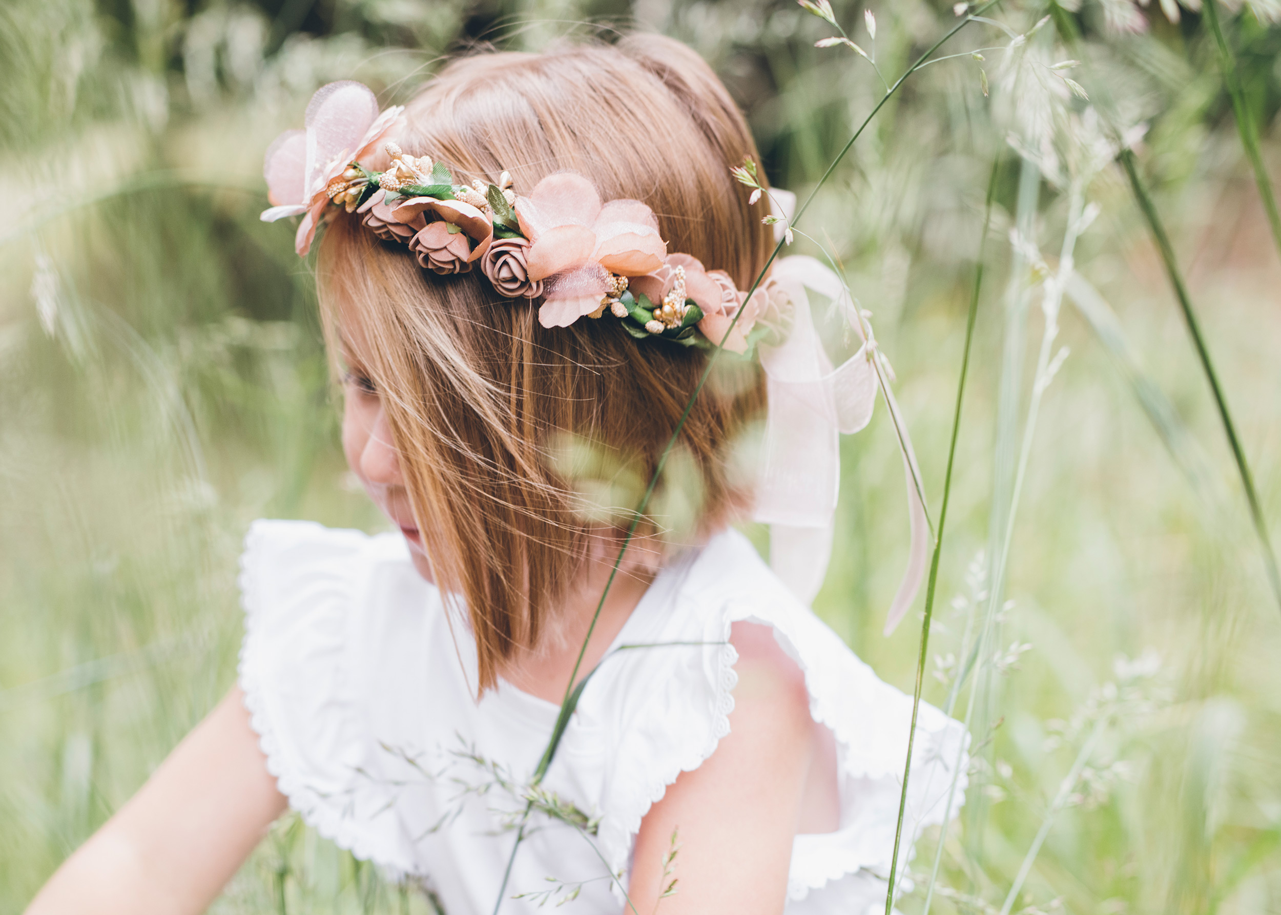 flower-girl-photographed-through-tall-grass.jpg