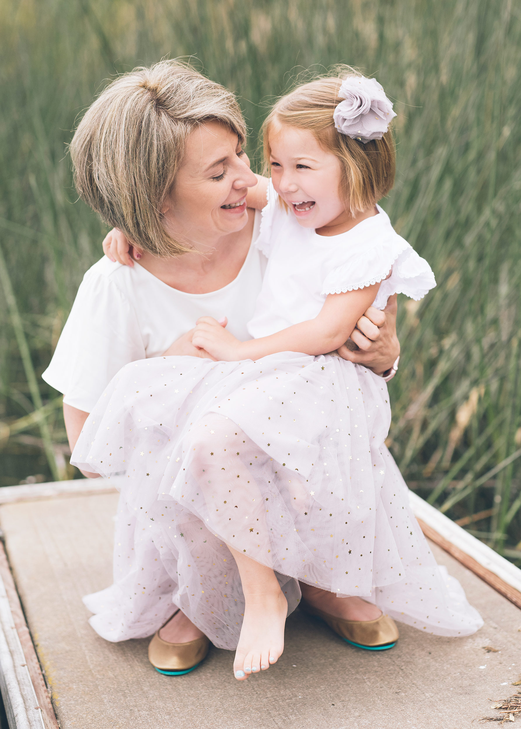 daughter-and-mother-laughing-during-lifestyle-portrait-session.jpg