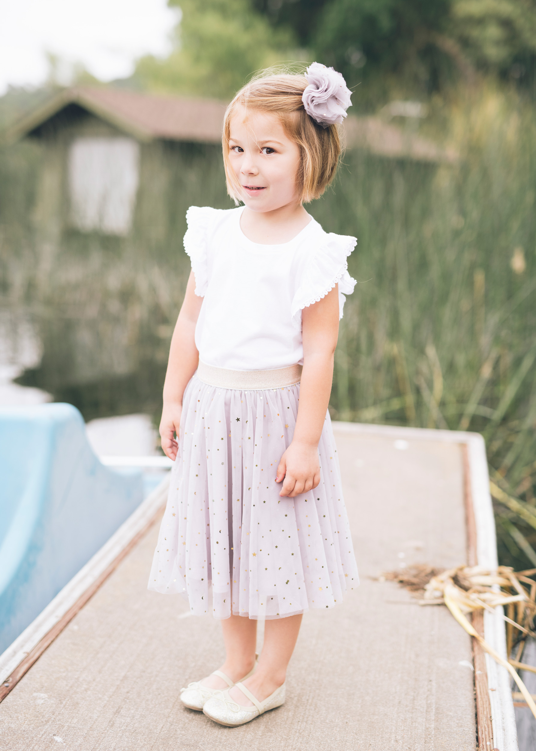 portrait-of-beautiful-four-year-old-girl-standing-on-a-dock.jpg