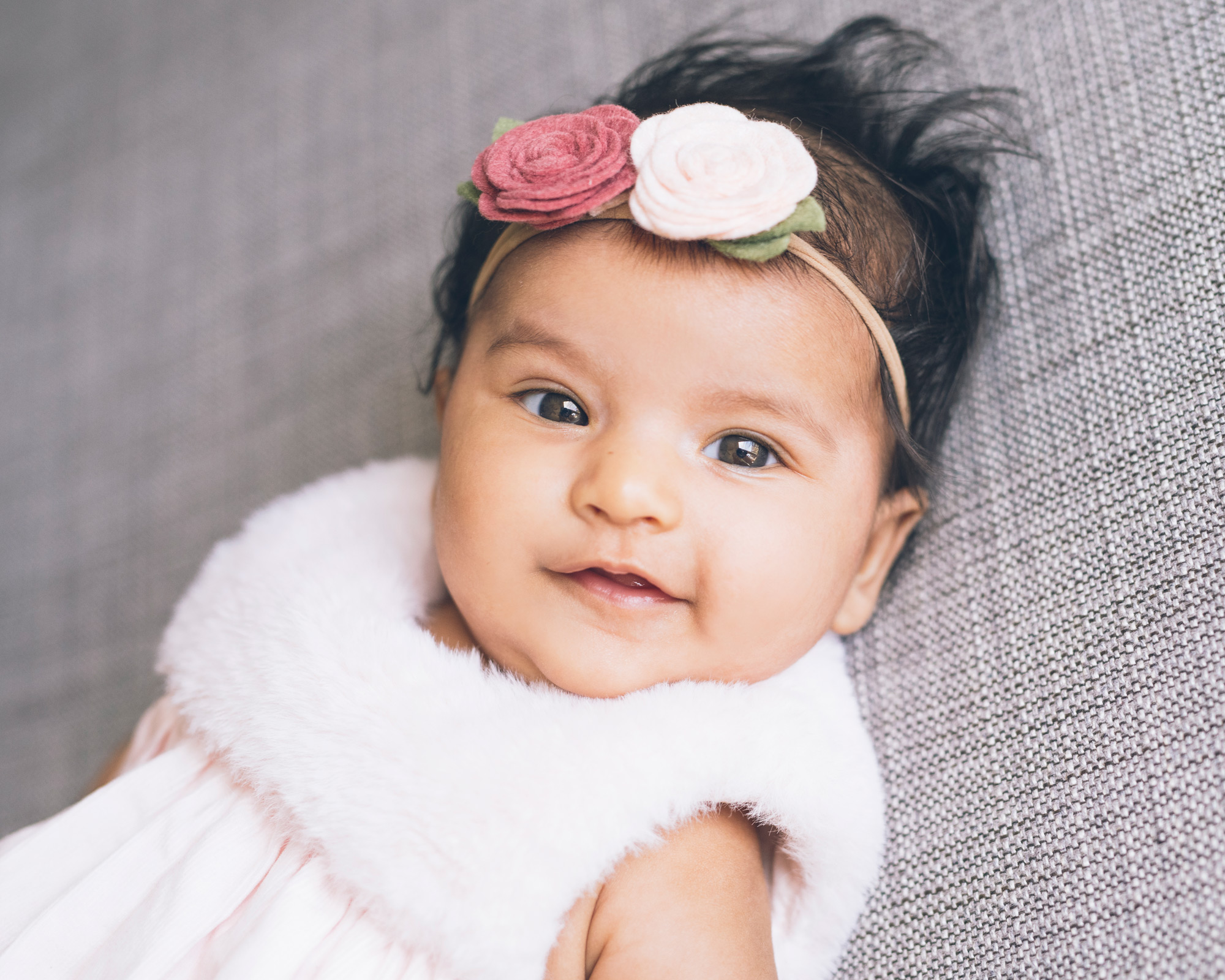 baby-girl-with-flower-headband-looking-at-the-camera.jpg
