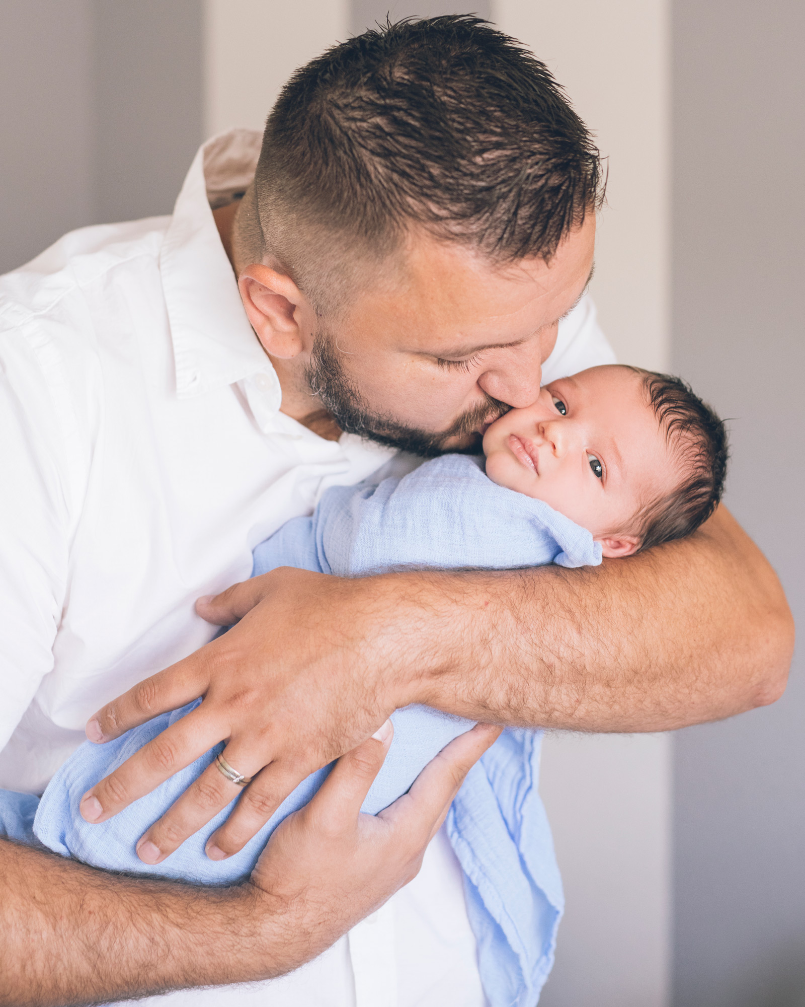 father-holding-and-kissing-his-newborn-baby-boy.jpg