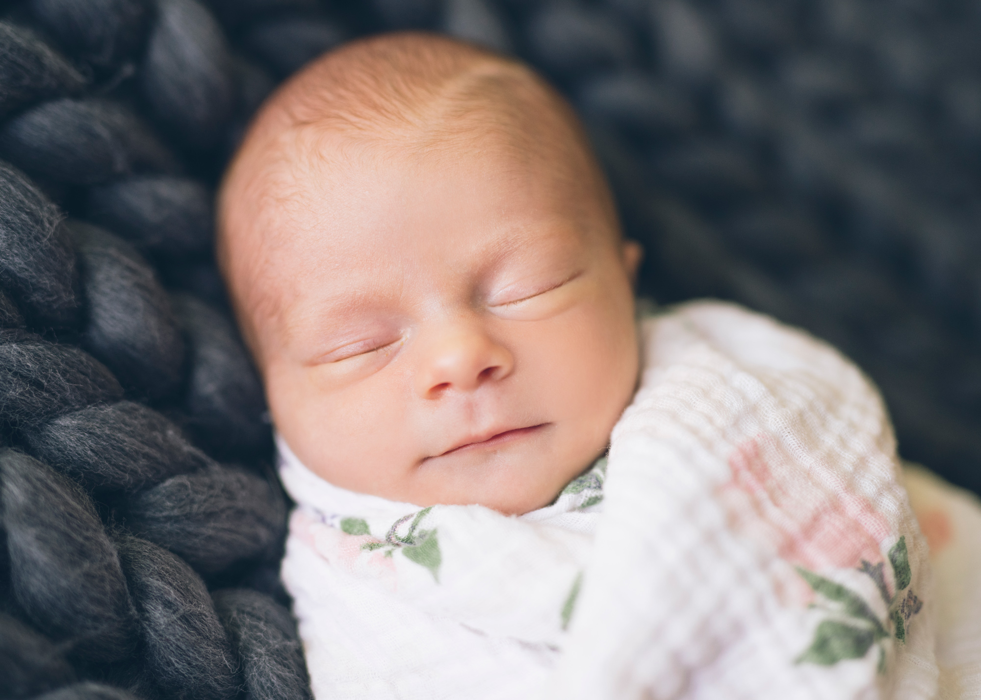 baby-girl-sleeping-on-a-chunky-grey-knit-blanket.jpg