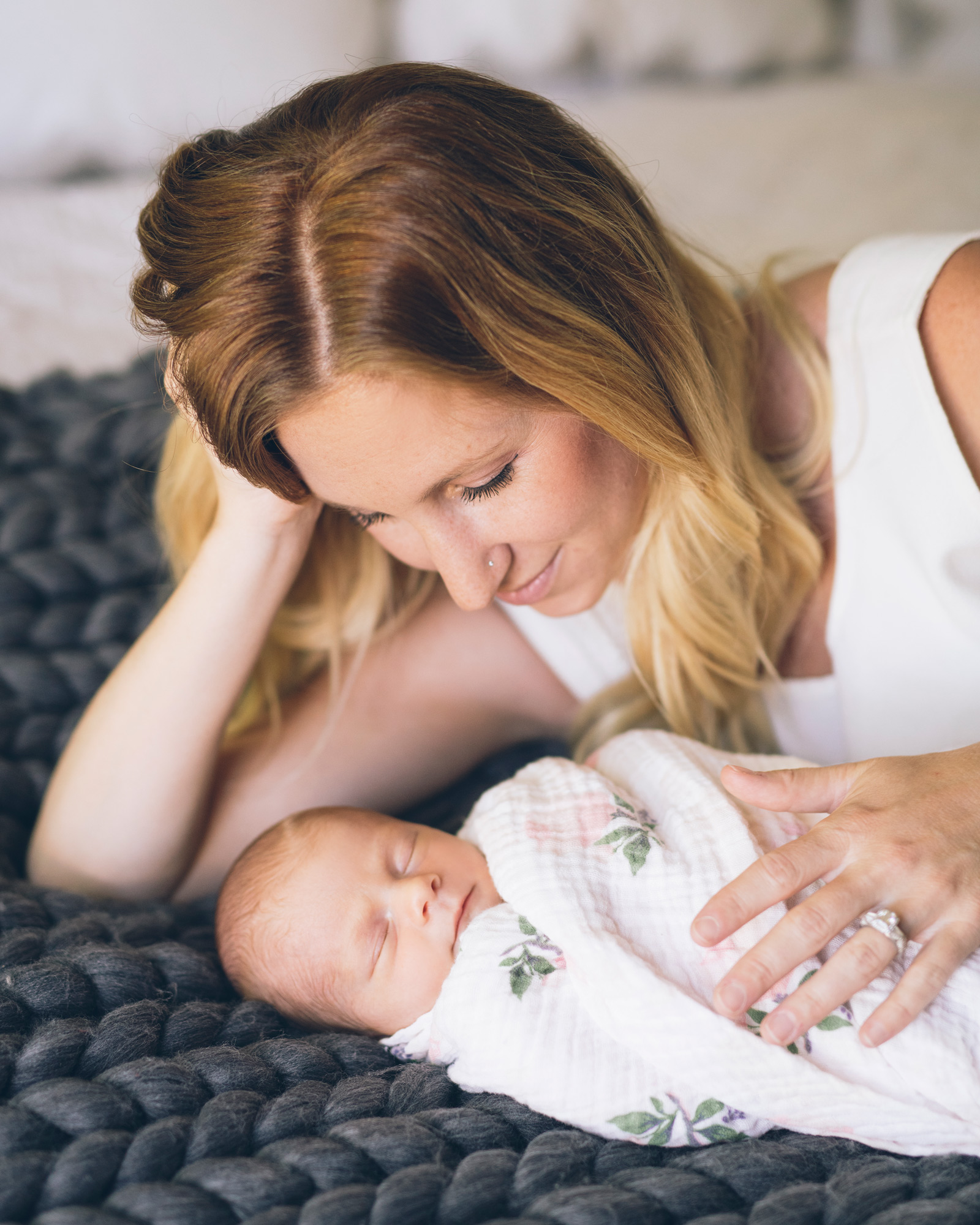 mother-looking-lovingly-at-her-newborn-baby-girl.jpg