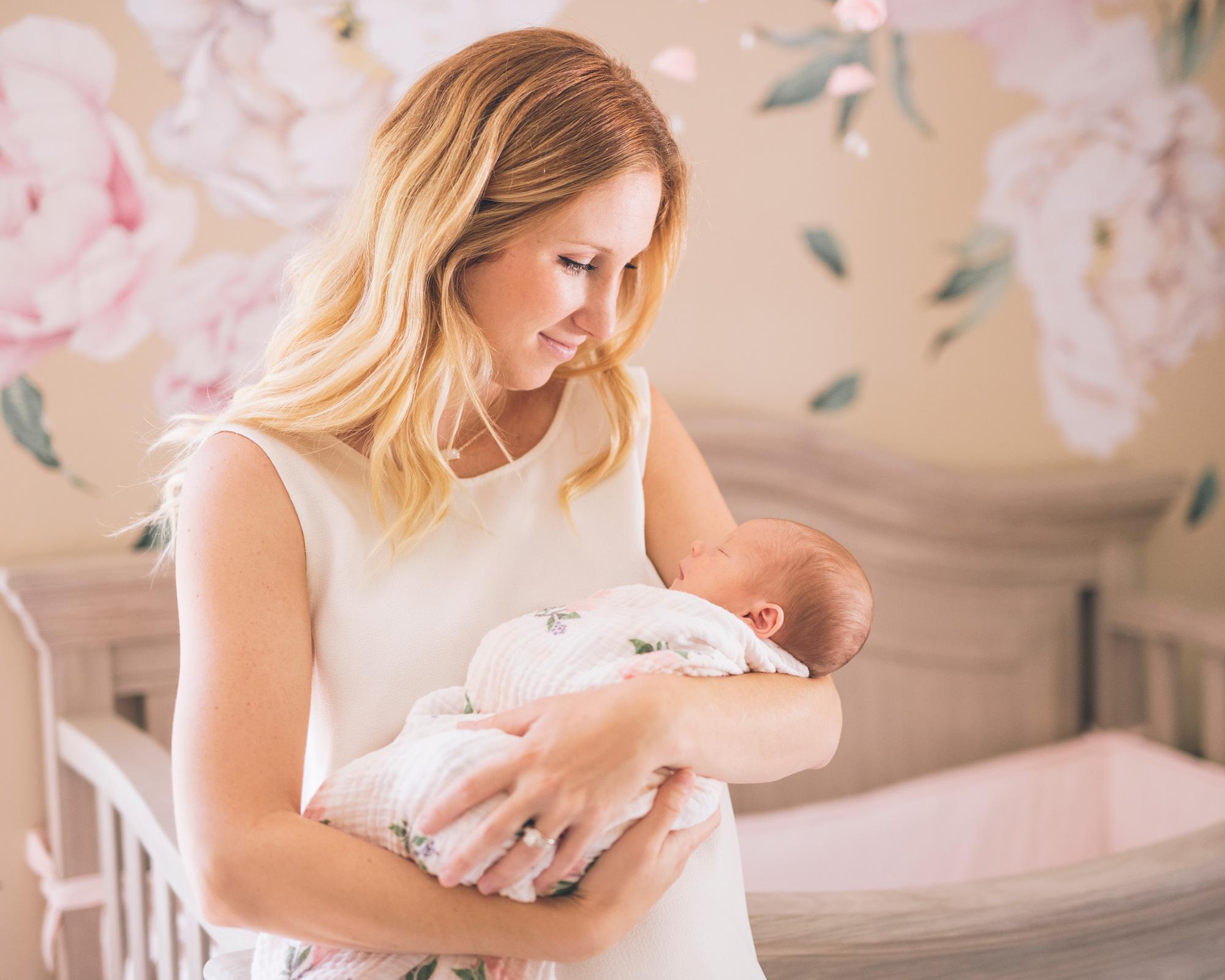 mother-holding-her-baby-daughter-in-a-beautiful-walnut-creek-nursery.jpg