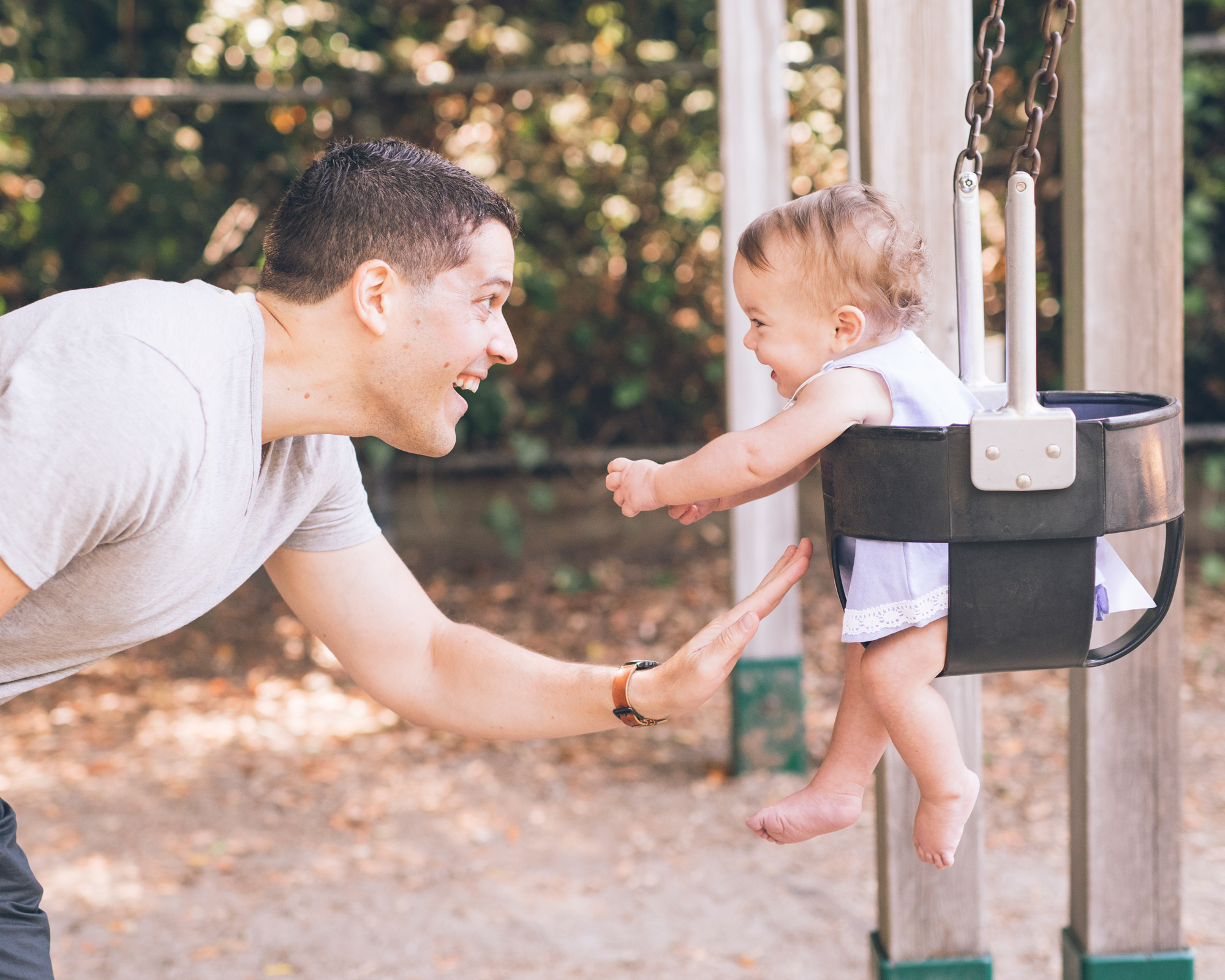 father-playing-with-his-daughter-in-the-swing.jpg