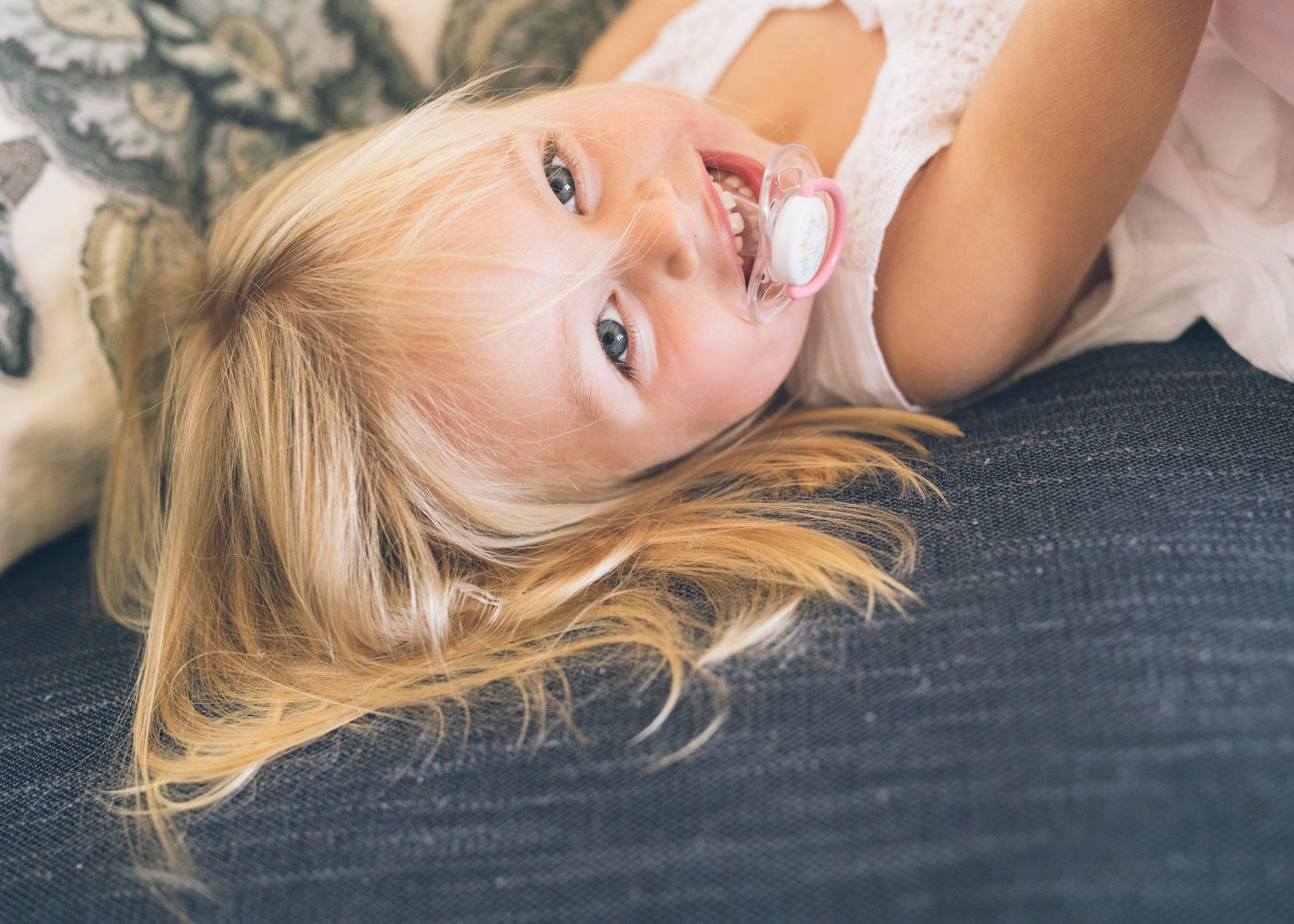 toddler-girl-smiling-during-a-family-photoshoot.jpg
