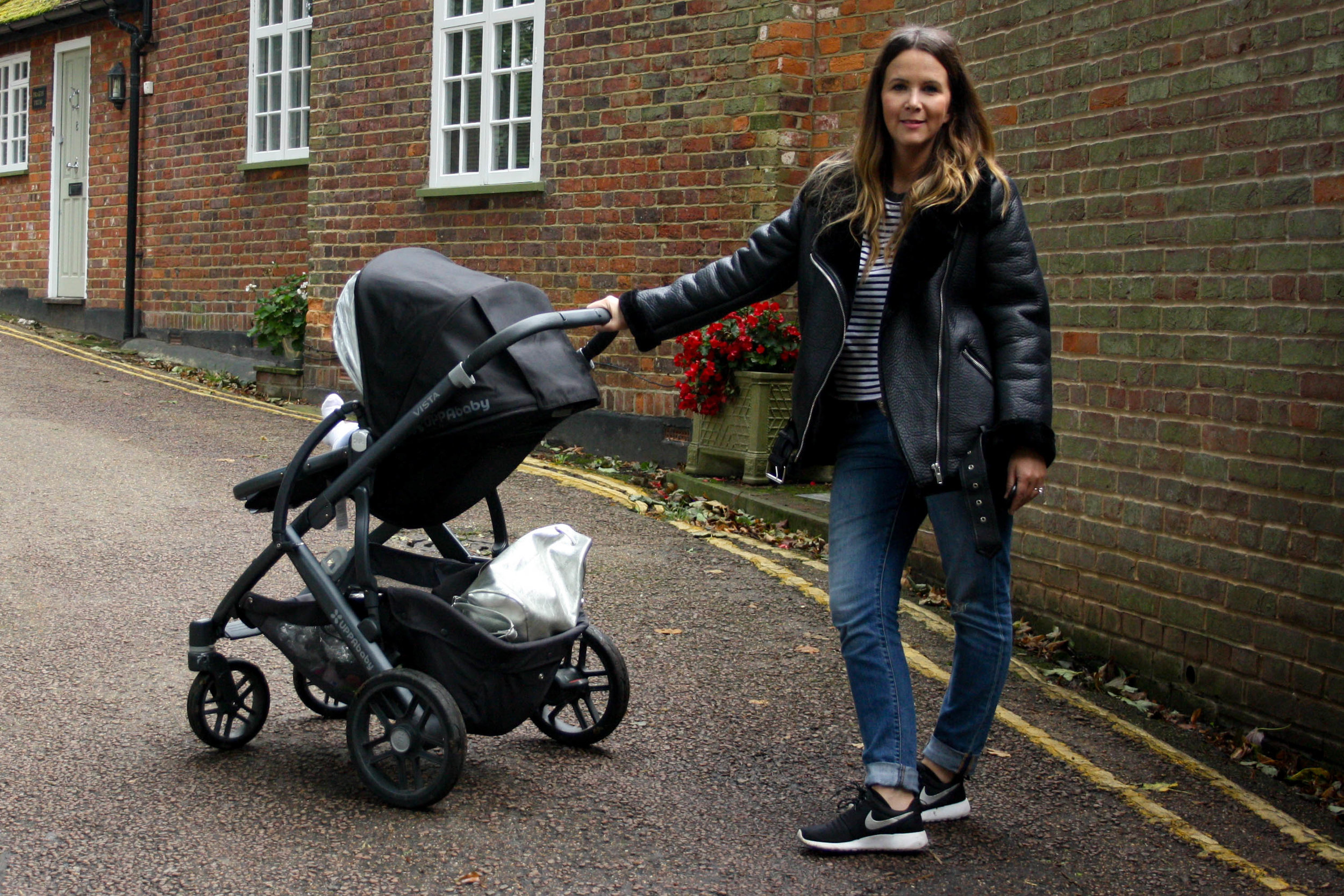 Jacket  Zara , Jeans  Levis , Top  Topshop , Trainers  Nike , Buggy  Uppababy