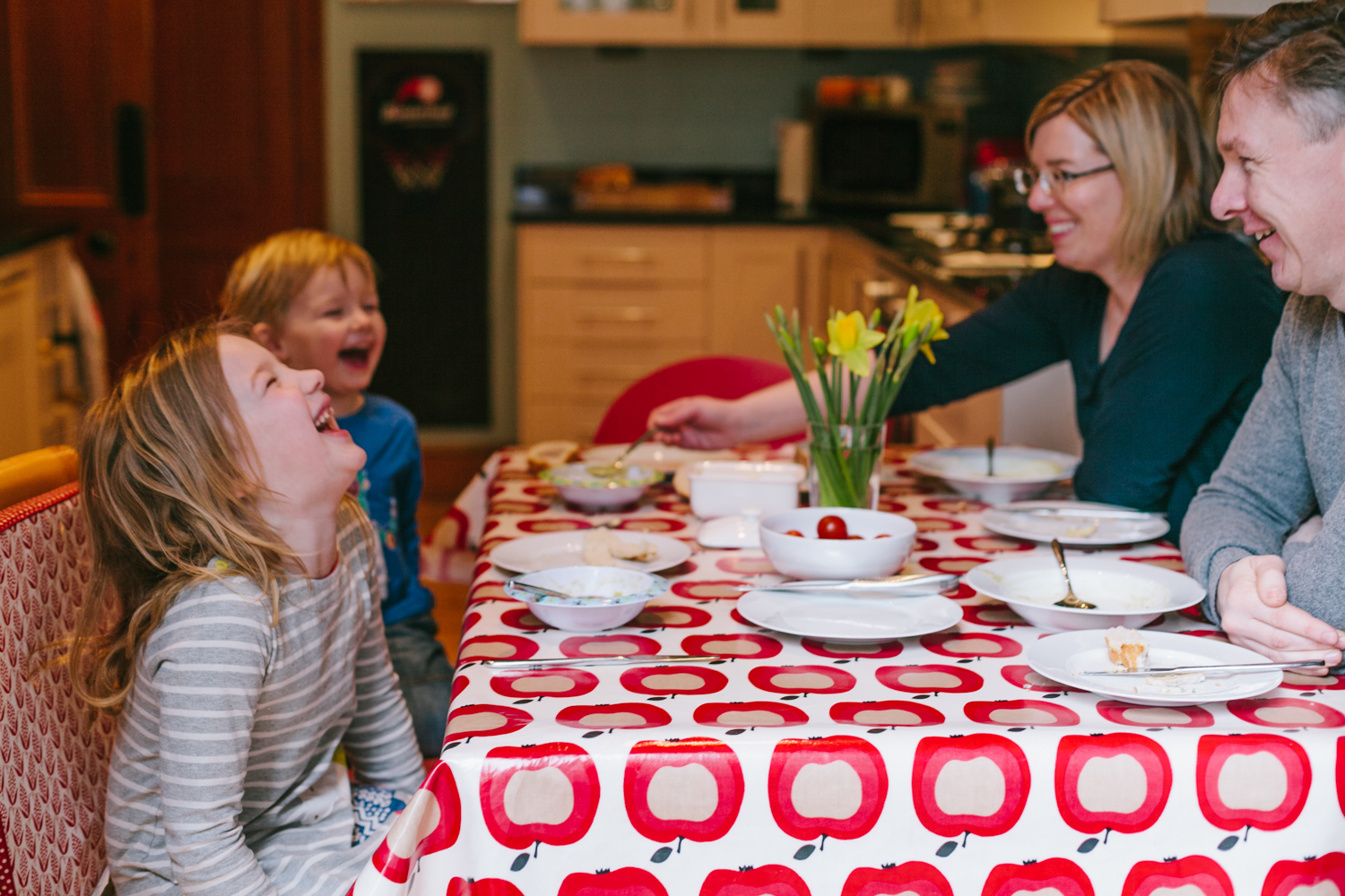 Family eating and laughing Andrea Thomson Photography