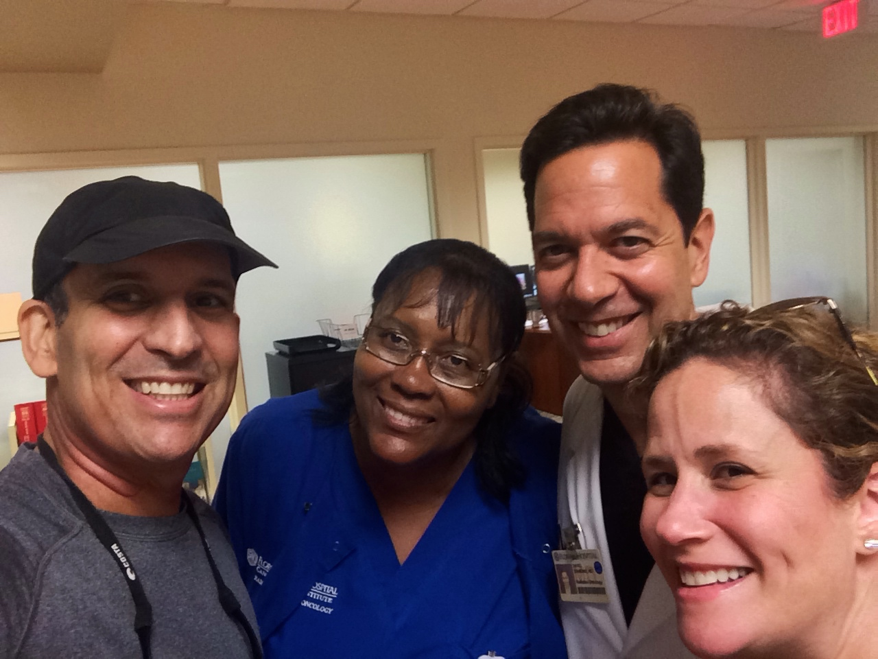 My radiation oncologist, his nurse and my wife after an appointment.