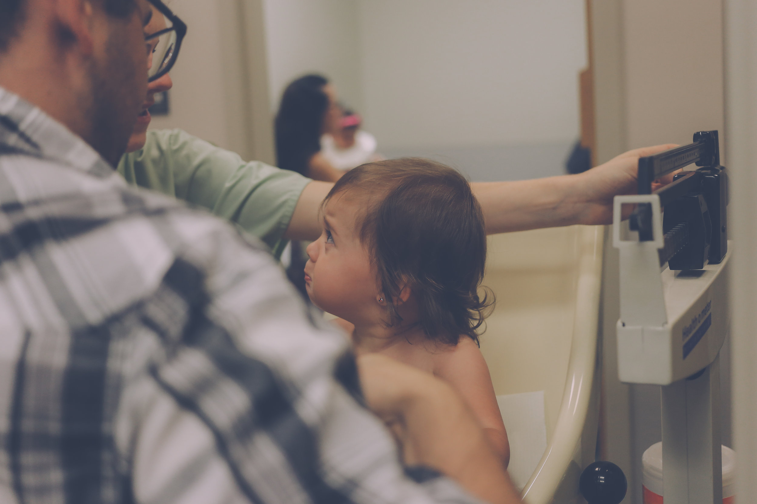 Getting weighed at Premier Pediatrics, Staten Island, NY, Family Documentary Photography