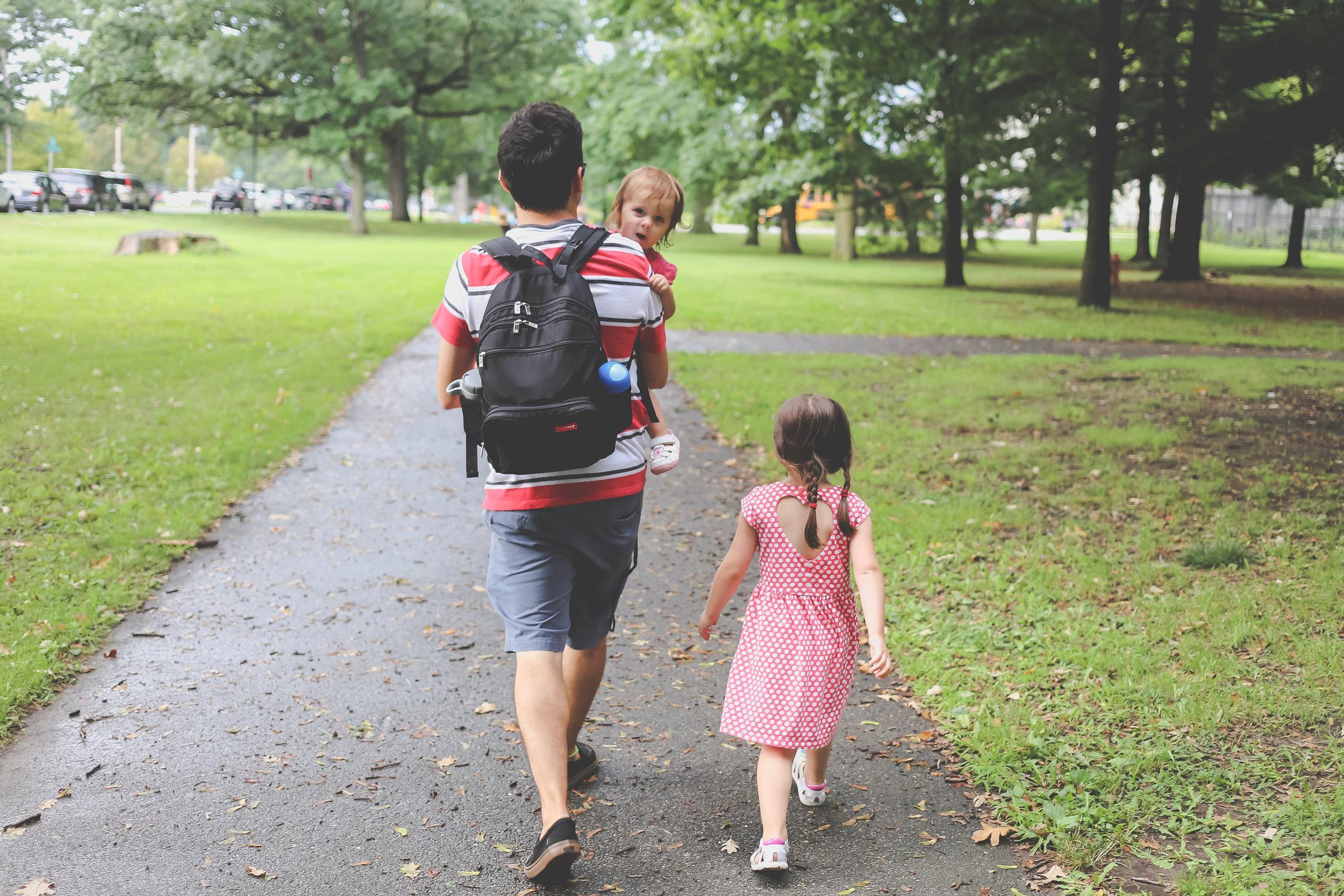 Walking through Fairmount Park, Philadelphia, PA. Family photojpurnalism.