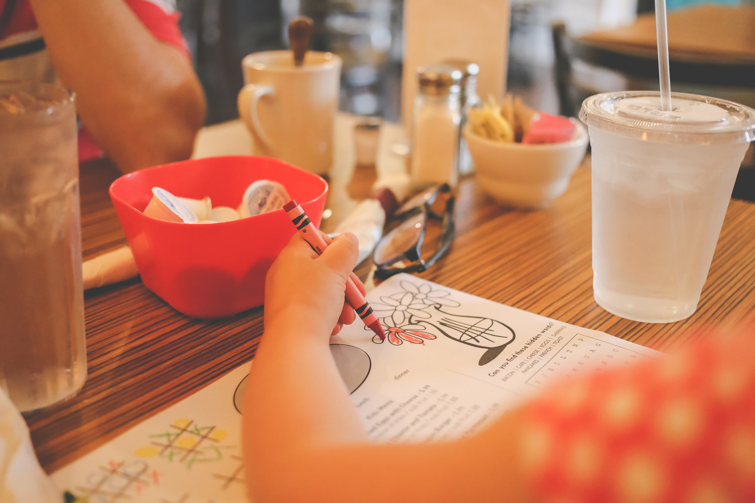 Coloring while waiting for our food at Sabrina's Cafe, Philadelphia, PA. Documentary Family Photography.