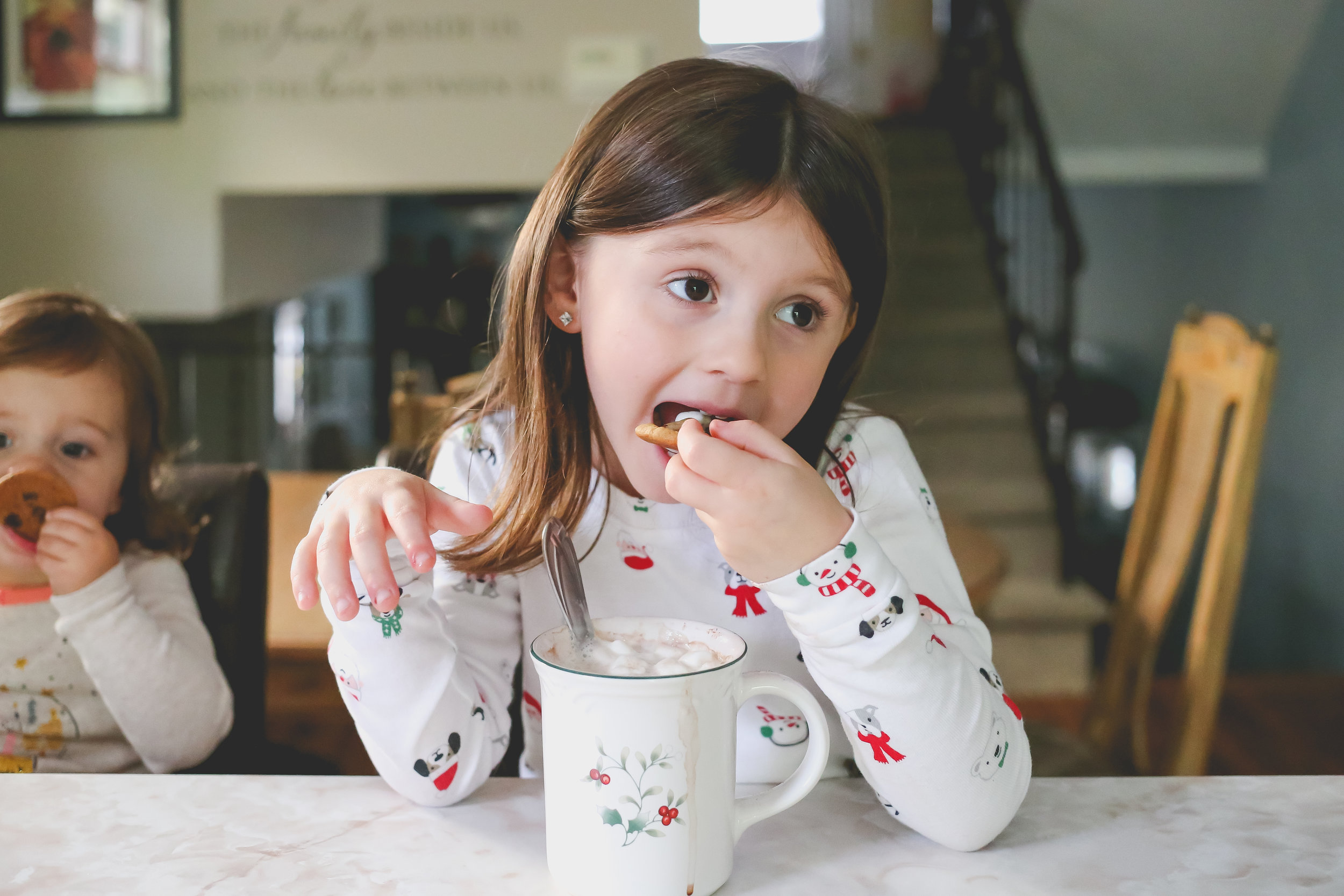 Dunking chocolate chip cookies in hot chocolate. New York family photographer.
