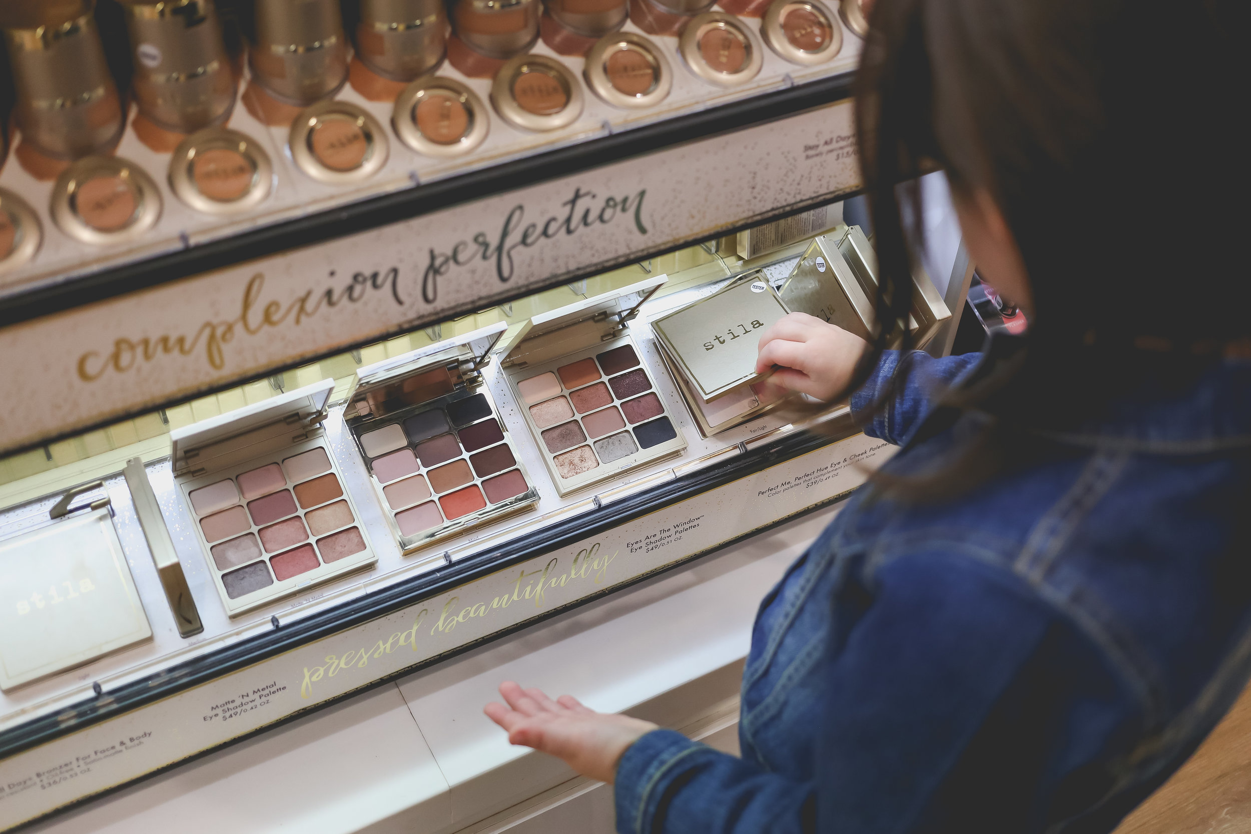 Shopping for makeup at Ulta beauty supply in Staten Island, NY. Documentary family photography.