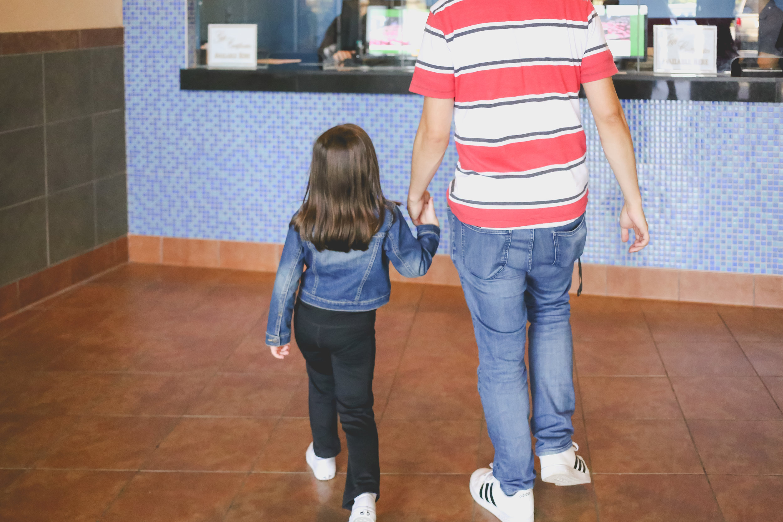 Arriving at The Atrium movie theater in Staten Island, NY. Day in the Life family photography.