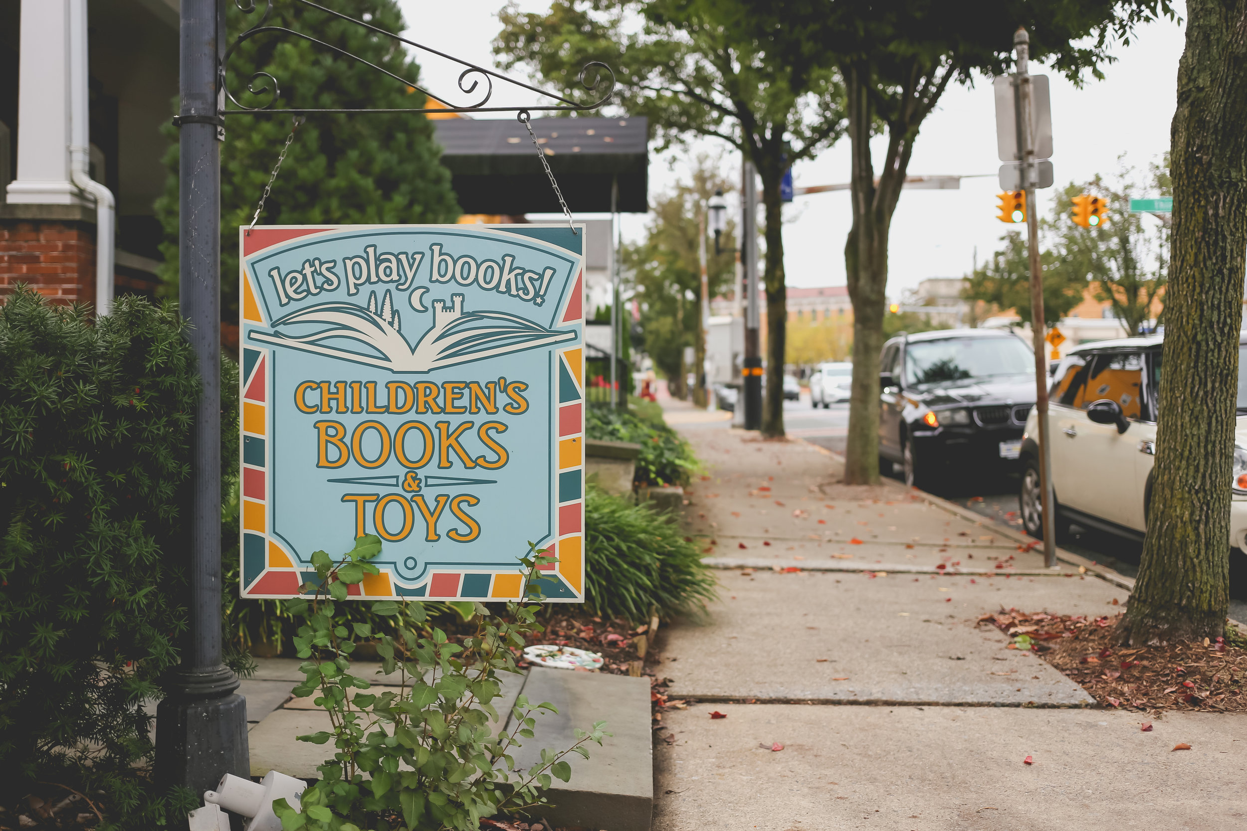 Sign for Let's Play Books on the quaint Main St. of Emmaus, PA.