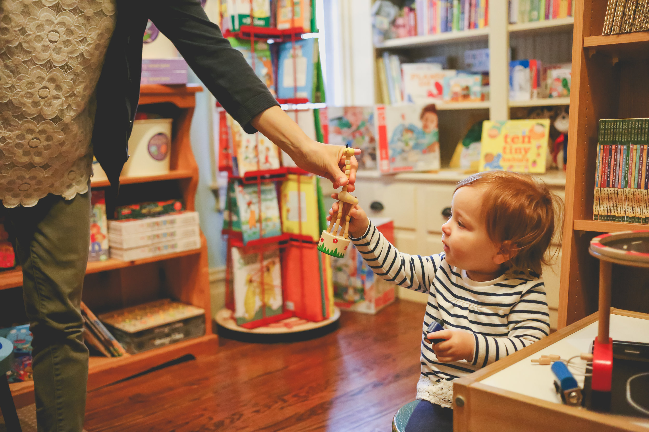 Toddler playing with toys at Let's Play Books in Emmaus, Pennsylvania. Lehigh Valley Documentary Family Photography.